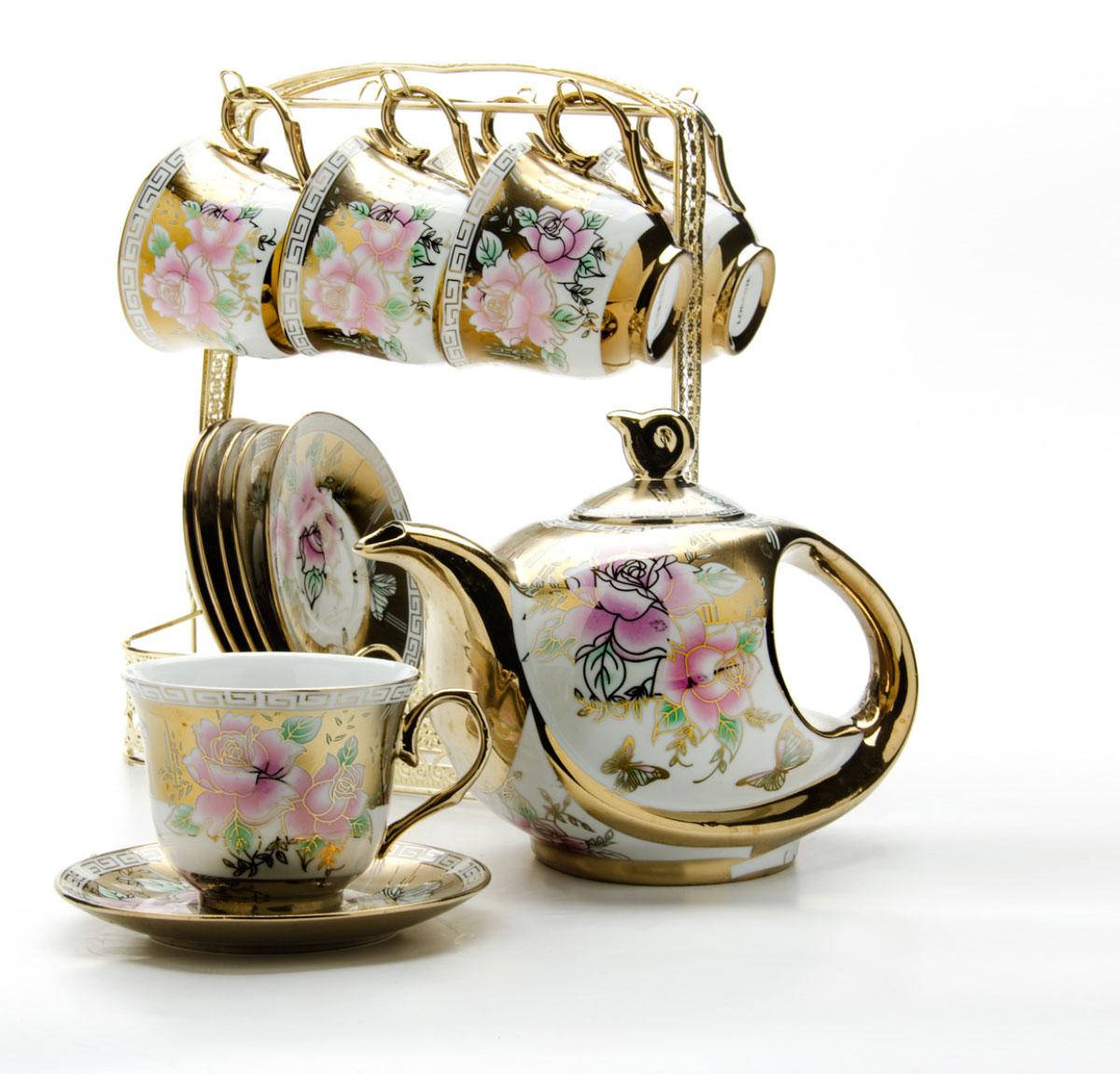 Набор чайный Loraine, на подставке, 15 предметов. 2478524785Чайный набор LORAINE состоит из шести чашек, шести блюдец и заварочного чайника. Предметы набора изготовлены из керамики и оформлены изображением цветов и бабочек. Все предметы располагаются на удобной металлической подставке с ручкой. Элегантный дизайн набора придется по вкусу и ценителям классики, и тем, кто предпочитает утонченность и изысканность. Он настроит на позитивный лад и подарит хорошее настроение с самого утра. Чайный набор LORAINE идеально подойдет для сервировки стола и станет отличным подарком к любому празднику.
