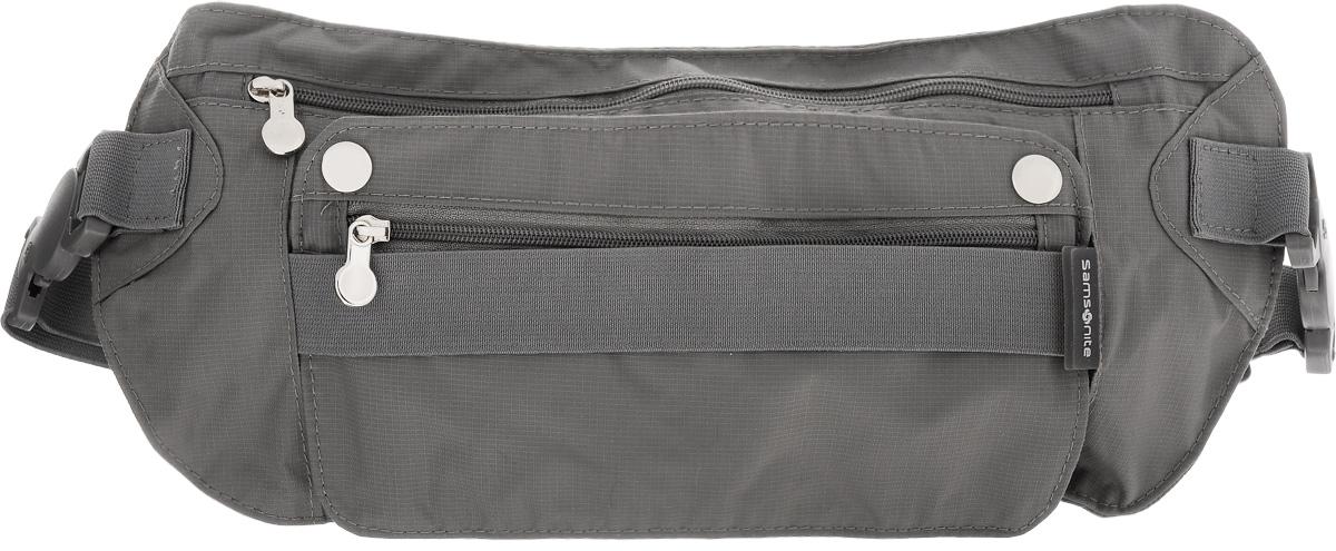Сумка поясная SamsoniteU23-18510Компактная поясная сумка Samsonite, выполненная из высококачественного, нейлона отлично подойдет для переноски самого необходимого. Сумка содержит одно вместительное отделение, закрывающееся на застежку-молнию. Лицевая сторона изделия дополнена съемным карманом. Эластичный поясной ремень фиксируется при помощи пластиковой пряжки. Длина ремня регулируется. Максимальный обхват поясного ремня составляет 114 см. Размер сумки: 31 х 14,5 см.