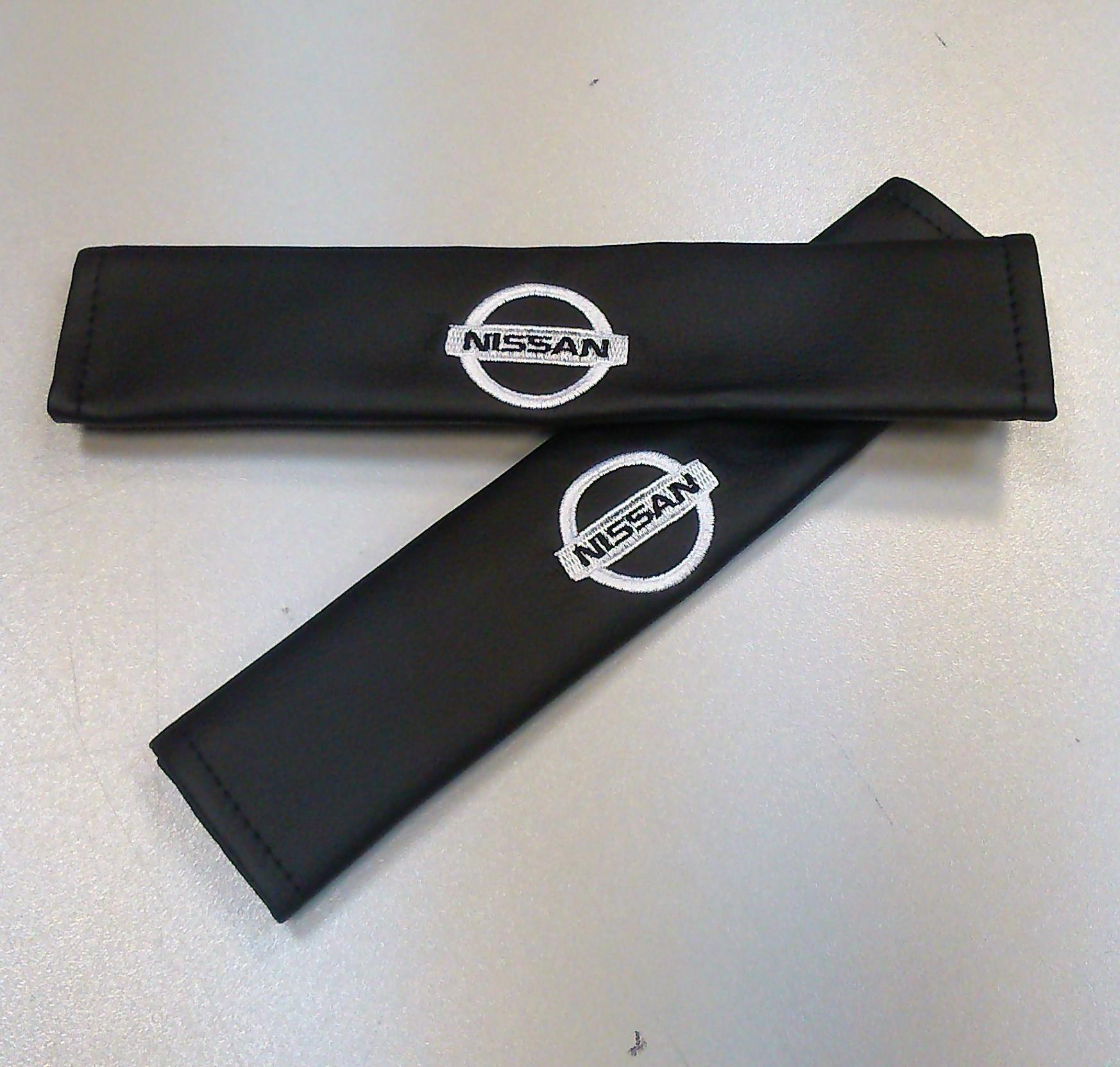 Накладки на ремень безопасности Auto Premium NISSAN, 2 шт67005Накладка на ремень безопасности легко закрепляется на ремне и решает ряд назойливых проблем: Ремень больше не натрет плечо, благодаря тому,что накладка сделана из мягкой экокожи и не мешает движению ремня. Накладка на ремень позволит защитить Вашу одежду от следов ремня безопасности. В жаркую погоду в местах соприкосновения с ремнем кожа не будет потеть, так как накладка выполнена из дышащего материала.