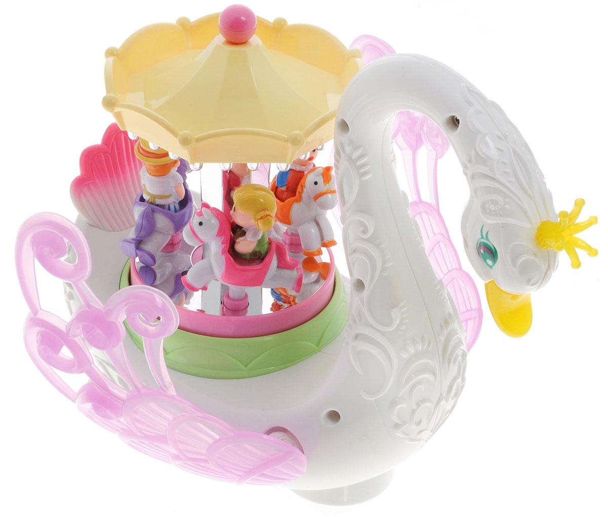 Huile Toys Развивающая игрушка Карусель Лебединый рай536Развивающая игрушка Huile Toys Карусель. Лебединый рай со звуковыми и световыми эффектами позволит ребенку погрузиться в мир сказок и поможет развить воображение. Игрушка развивает такие навыки как цветовосприятие и восприятие звуков. Фигурки на карусели движутся вверх и вниз, карусель вращается, крылья лебедя опускаются и поднимаются. Лебедь меняет направление движения при столкновении с препятствиями, корона и клюв лебедя излучают золотистый свет. Карусель изготовлена из качественных и безопасных материалов. Необходимо купить 3 батарейки напряжением 1,5V типа АА (не входят в комплект).