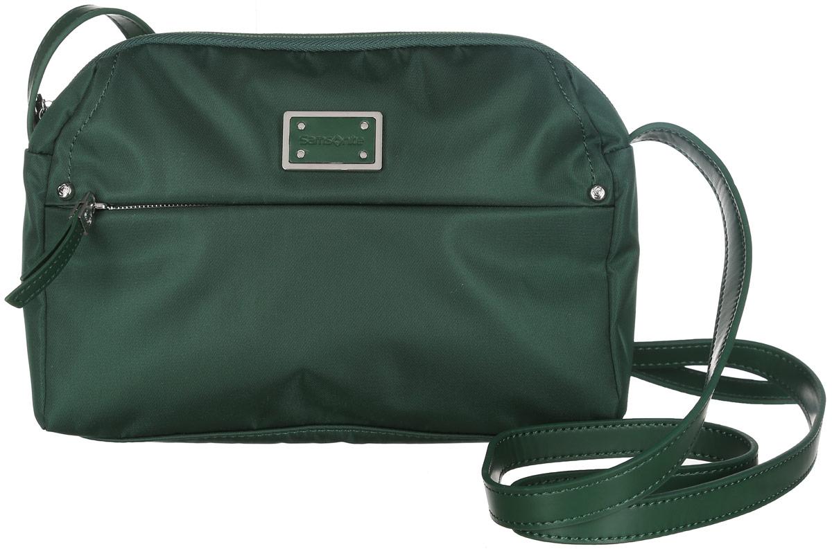 Сумка женская Samsonite, цвет: зеленый. 22D-1400322D-14003Компактная женская сумка Samsonite изготовлена из полиамида и полиуретана, оформлена металлической пластиной с символикой бренда. Изделие содержит одно основное отделение, закрывающееся на застежку-молнию. Внутри отделения расположен врезной карман на молнии. Лицевая сторона сумки дополнена потайным карманом на молнии. На задней стороне изделия расположен накладной карман на магнитной кнопке. Сумка оснащена наплечным ремнем регулируемой длины. Стильный аксессуар позволит вам завершить образ и быть неотразимой.