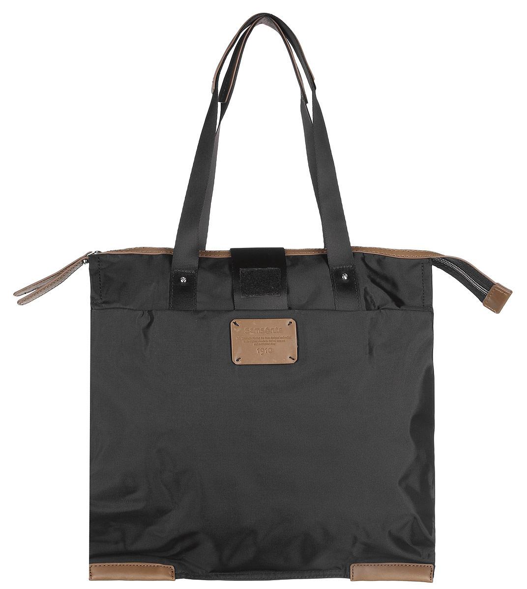 Сумка складная Samsonite, цвет: черный. 52V-0900152V-09001Складная женская сумка Samsonite выполнена из полиамида с добавлением полиуретана и оформлена контрастными вставками и нашивкой логотипа бренда. Изделие содержит одно вместительное отделение, закрывающееся на застежку-молнию. На внешней стороне сумки есть прорезной открытый карман. Сумка оснащена двумя удобными ручками, высота которых позволяет носить сумку как в руке, так и на плече. Сумка не имеет жесткой структуры, за счет чего быстро складывается и фиксируется хлястиком с липучкой и не занимает много места. Такая сумка будет удобна в хранении и в использовании.