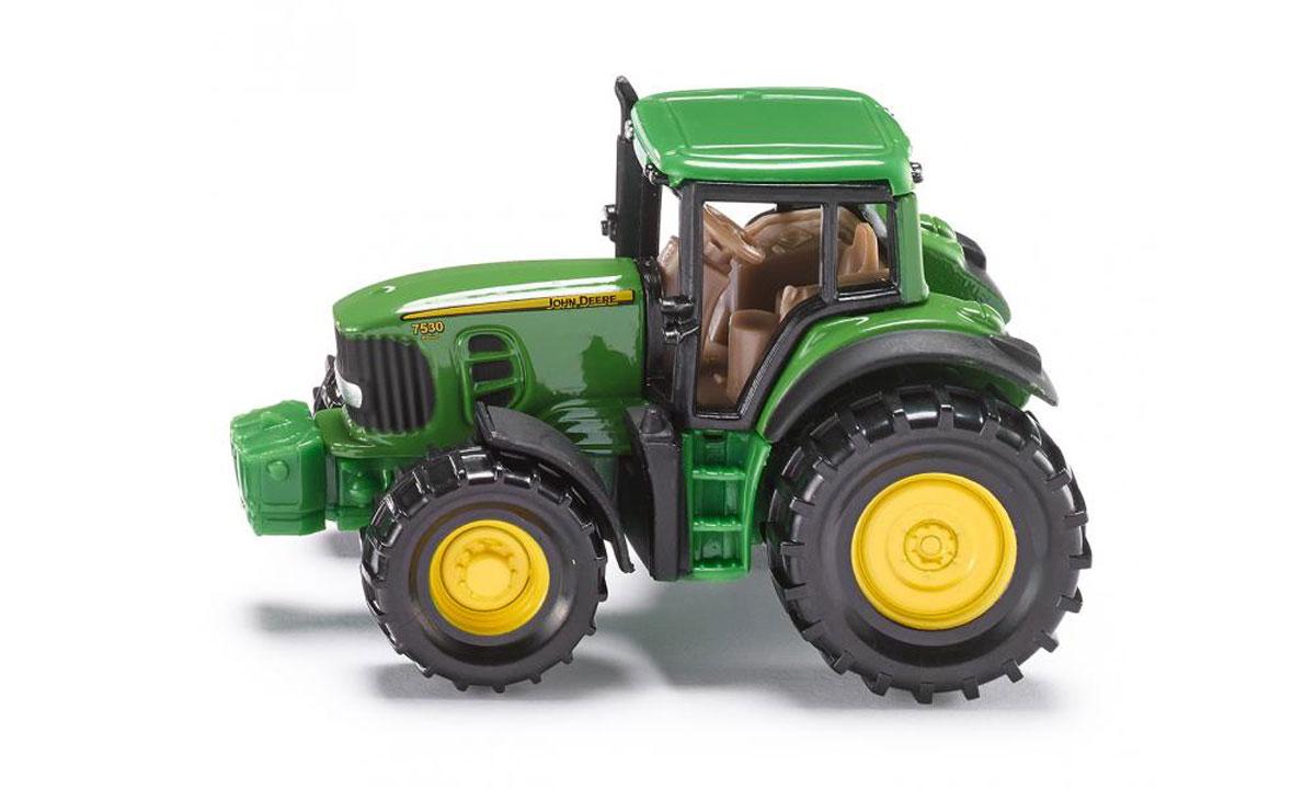 Siku Трактор John Deere 75301009Трактор Siku John Deere выполнен в виде точной копии трактора. Такая модель понравится не только ребенку, но и взрослому коллекционеру и приятно удивит вас высочайшим качеством исполнения. Корпус трактора выполнен из металла с пластиковыми элементами, колеса прорезинены и имеют свободный ход. Модель отличается великолепным качеством исполнения и детальной проработкой, она станет не только интересной игрушкой для ребенка, интересующегося агротехникой, но и займет достойное место в любой коллекции.