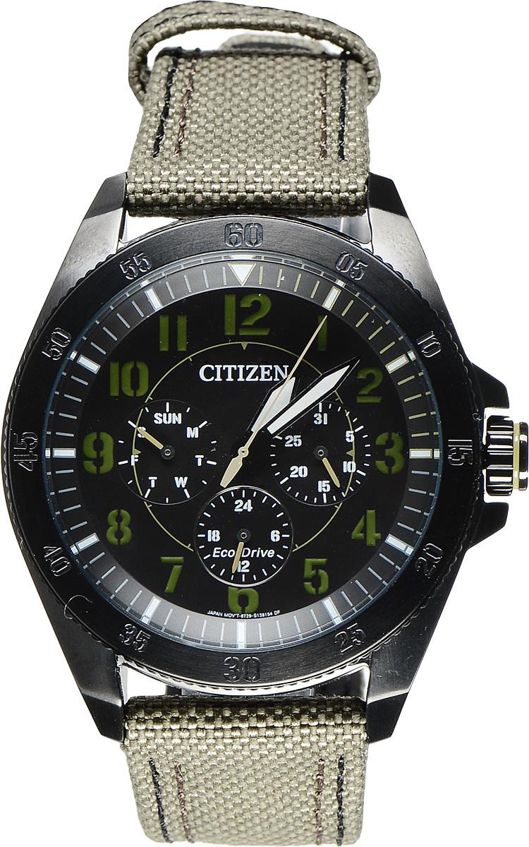 Часы наручные мужские Citizen Eco-Drive, цвет: черный, хаки. BU2035-05EBU2035-05EСтильные мужские часы Citizen Eco-Drive выполнены из нержавеющей стали и минерального стекла. Циферблат изделия оформлен символикой бренда. Корпус часов оснащен степенью влагозащиты 10 bar, функцией отображения времени в формате 12/24, а также устойчивым к царапинам минеральным стеклом. Циферблат дополнен индикатором числа, индикатором дня недели. Идеально дополняющий корпус изделия текстильный ремешок оснащен застежкой-пряжкой, которая позволит максимально комфортно снимать и надевать часы. Современная технология Eco-Drive позволяет заряжать аккумулятор изделия с помощью любого естественного или искусственного источника света. Изделие поставляется в фирменной упаковке. Часы Citizen Eco-Drive подчеркнут мужской характер и отменное чувство стиля у их обладателя.