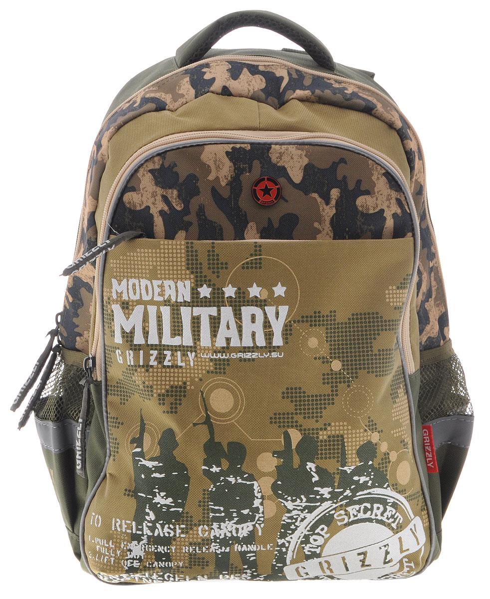 Grizzly Рюкзак детский Modern Military цвет хакиRB-632-2/3Школьный рюкзак Grizzly Modern Military - это стильный рюкзак, который подойдет всем, кто хочет разнообразить свои школьные будни. Выполнен из плотного полиэстера цвета хаки. Благодаря уплотненной спинке и двум мягким плечевым ремням, длина которых регулируется, у ребенка не возникнут проблемы с позвоночником. Конструкция спинки дополнена двумя эргономичными подушечками, противоскользящей сеточкой и системой вентиляции для предотвращения запотевания спины ребенка. Рюкзак состоит из двух основных вместительных отделений, закрывающихся на застежки-молнии. Большое основное отделение содержит небольшой карман на молнии. Лицевая сторона оснащена накладным карманом на застежке-молнии. По бокам рюкзака расположены два небольших сетчатых кармана. Для удобной переноски предусмотрена текстильная ручка. Такой школьный рюкзак станет незаменимым спутником вашего ребенка в походах за знаниями.