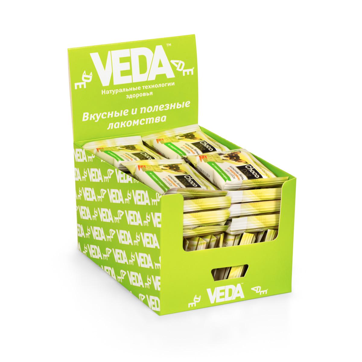 Лакомство VEDA Choco Dog, для собак, в шоу-боксе, белый шоколад с морковью, 40 шт4605543006609В состав лакомства VEDA Choco Dog введены натуральные ингредиенты, которые известны своим полезным действием на организм: - Морковь способствует профилактике сердечных и глазных заболеваний; - Инулин (пребиотик) поддерживает полезную микрофлору кишечника; - Рис благодаря наличию витаминов группы В, витамина Е, ряда микроэлементов полезен для костей, сердца и сосудов. Состав: заменитель масла какао, лактоза, сухая молочная сыворотка, морковь сушеная, пивные дрожжи, лецитин, стевиозид, пищевой ароматизатор. Количество: 40 шт. Вес (1 шт): 15 г. Товар сертифицирован.