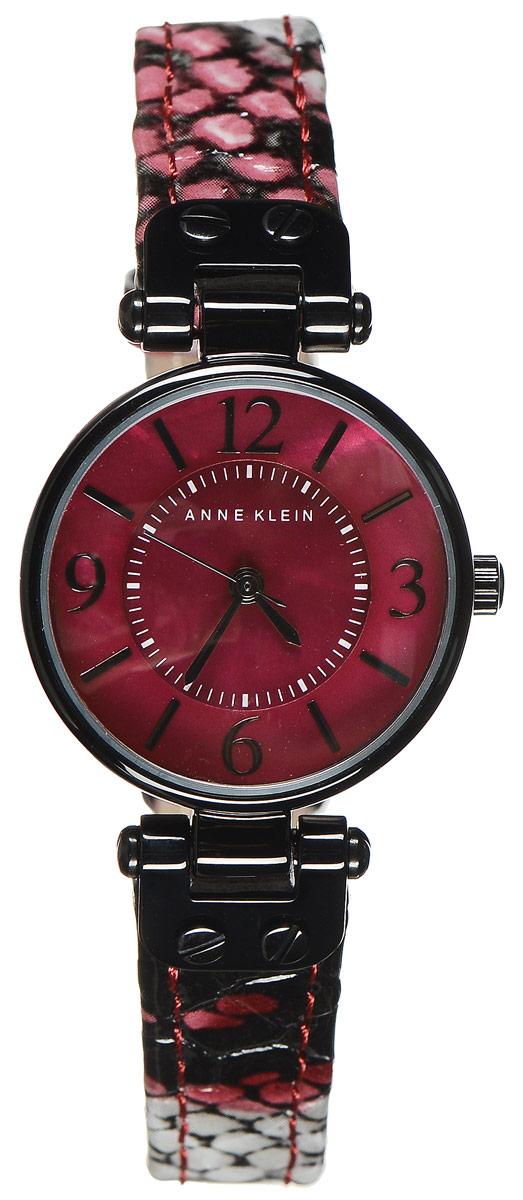 Часы наручные женские Anne Klein, цвет: черный, красный, серый. 9443 BMBY9443 BMBYЭлегантные женские часы Anne Klein выполнены из металлического сплава. Циферблат изделия дополнен натуральным перламутром и символикой бренда. Часы оснащены кварцевым механизмом с тремя стрелками, полированным корпусом со степенью влагозащиты 3 bar и устойчивым к царапинам минеральным стеклом. Изделие дополнено изящным кожаным ремешком, оформленным фактурным тиснением под кожу рептилии. Часы поставляются в фирменной упаковке. Стильные часы Anne Klein подчеркнут изящество женской руки и отменное чувство стиля их обладательницы.