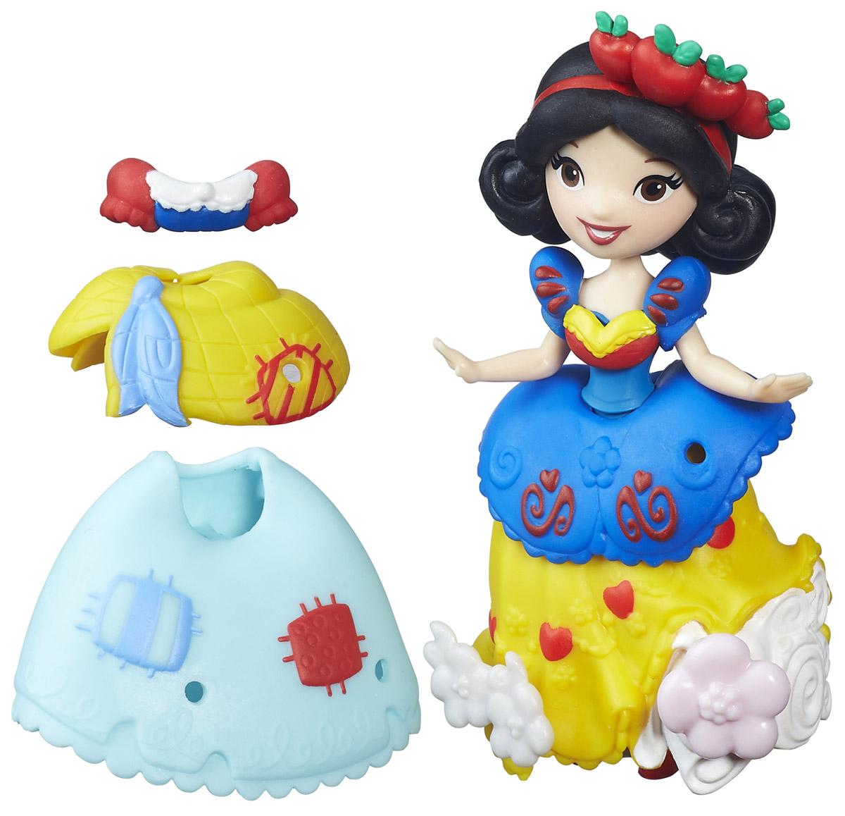Disney Princess Мини-кукла Белоснежка и модные нарядыB5327EU4_B5330Мини-кукла Disney Princess Белоснежка и модные наряды входит в серию Маленькое королевство. Кукла небольшого роста, но очень похожа на героиню мультфильма. Малышка тщательно проработана и радует количеством декоративных элементов. Черные волосы Белоснежки украшены красным бантом, большие карие глаза приветливо смотрят на мир, нежная улыбка очаровывает с первого взгляда. На куклу надето платье, в котором с первого взгляда узнается наряд героини: синий верх, желтая юбка, рукава-фонарики с красными вставками. Тем не менее, платье мини-куклы имеет больше интересных деталей, а какую-то часть из них можно добавить самостоятельно! В комплекте находятся пластиковые элементы, которые можно вставить в одежду принцессы. Кукла станет замечательным подарком вашей малышке, а дополнительные аксессуары разнообразят игру.