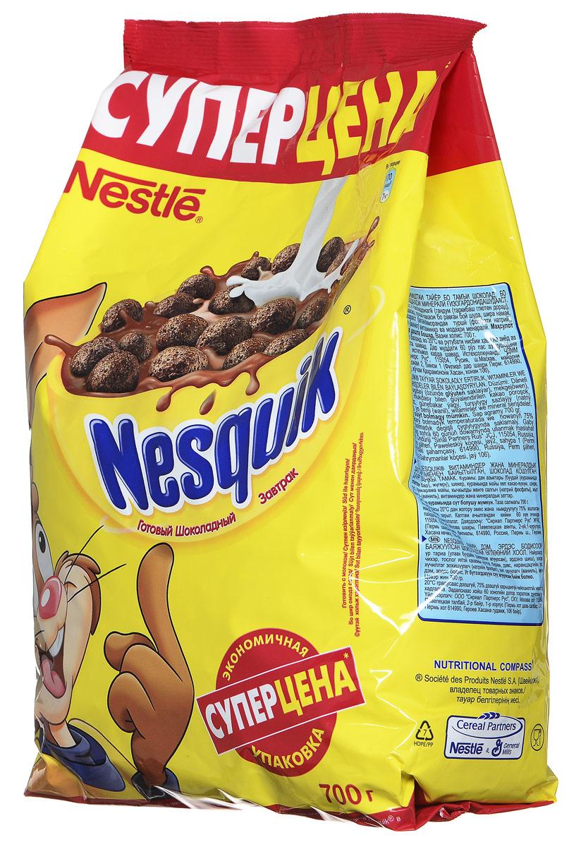"""Готовый завтрак Nestle Nesquik """"Шоколадные шарики"""" - такой вкусный и невероятно шоколадный завтрак! Тарелка полезного для здоровья готового завтрака Nesquik в сочетании с молоком - это прекрасное начало дня. В состав готового завтрака Nesquik входят цельные злаки (природный источник клетчатки), а также он обогащен витаминами и минеральными веществами, которые помогают расти здоровым и умным. Какао - секрет волшебного шоколадного вкуса Nesquik, который так нравится детям. Дети любят готовый завтрак Nesquik за чудесный шоколадный вкус, а мамы - за его пользу. Рекомендуется употреблять с молоком, кефиром, йогуртом или соком."""