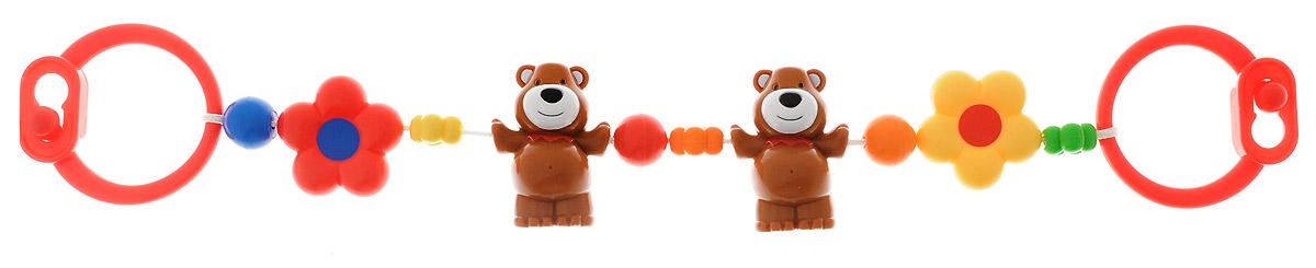 Simba Погремушка-подвеска на коляску Мишки4016664_красныйПогремушка-подвеска на коляску Simba Мишки не оставит вашего малыша равнодушным и не позволит ему скучать! Подвеска выполнена в виде пластиковых мишек и ярких цветочков, нанизанных на прочный шнурок. Фигурки дополнены гремящими элементами. На концах шнурка имеются пластиковые клипсы-держатели, при помощи которых игрушку удобно крепить не только на коляску, но и на кроватку, автомобильное кресло. Ваш ребенок с удовольствием будет изучать яркие элементы подвески. Погремушка-подвеска поможет вашему малышу познакомиться с основными цветами и развить звуковосприятие и мелкую моторику рук.