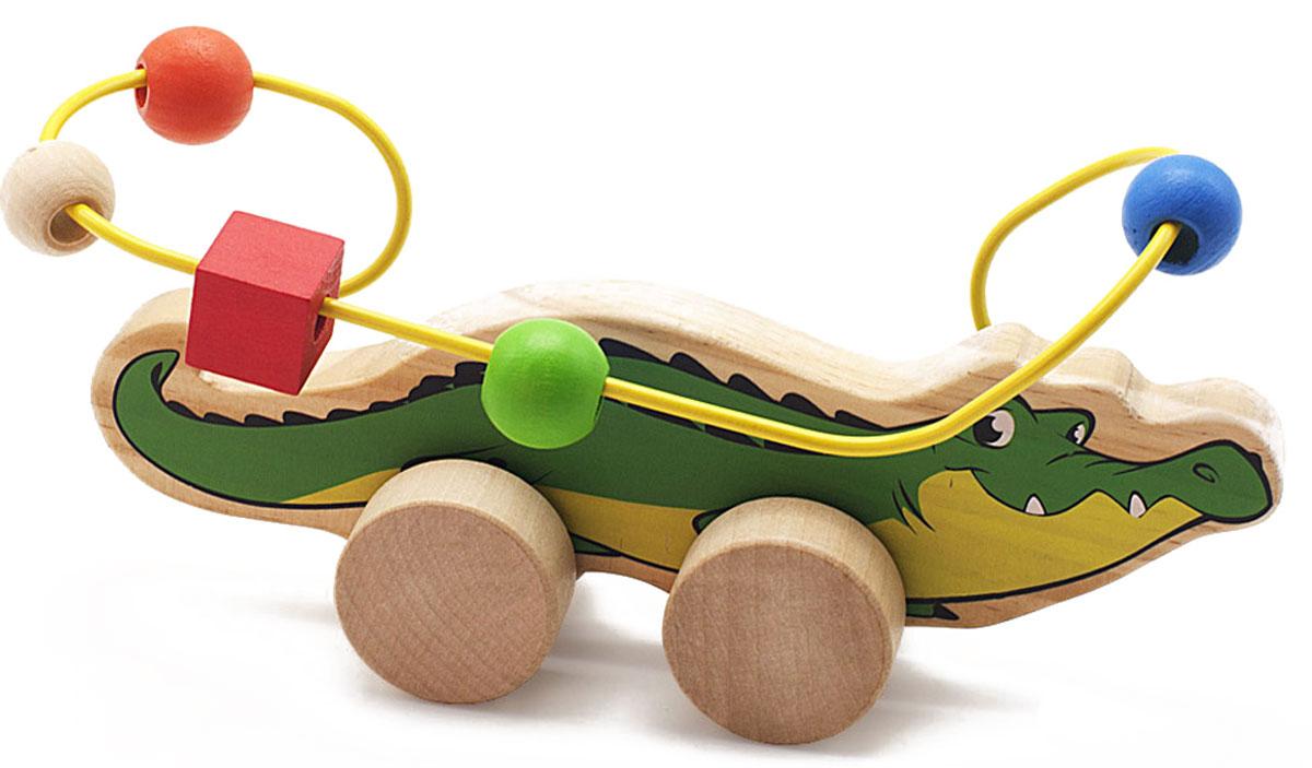 Мир деревянных игрушек Лабиринт-каталка КрокодилД362Лабиринт-каталка Мир деревянных игрушек Крокодил - это замечательная игрушка для малышей! Игрушка в виде крокодила на колесиках выполнена из качественных материалов по европейским стандартам и покрыта специальной краской на водной основе, которая абсолютно безопасна для вашего малыша. Производитель использует только экологически чистую новозеландскую сосну для производства своих игрушек. К фигурке крокодила прикреплена изогнутая проволока, по которой свободно могут двигаться фигурки, различные по цвету и форме. Мелкие детали не снимаются. Благодаря большим деревянным колесам малыш сможет использовать игрушку и как каталку. Лабиринт-каталка развивает моторику рук, логическое мышление, а также знакомит малыша с основными цветами и формами.