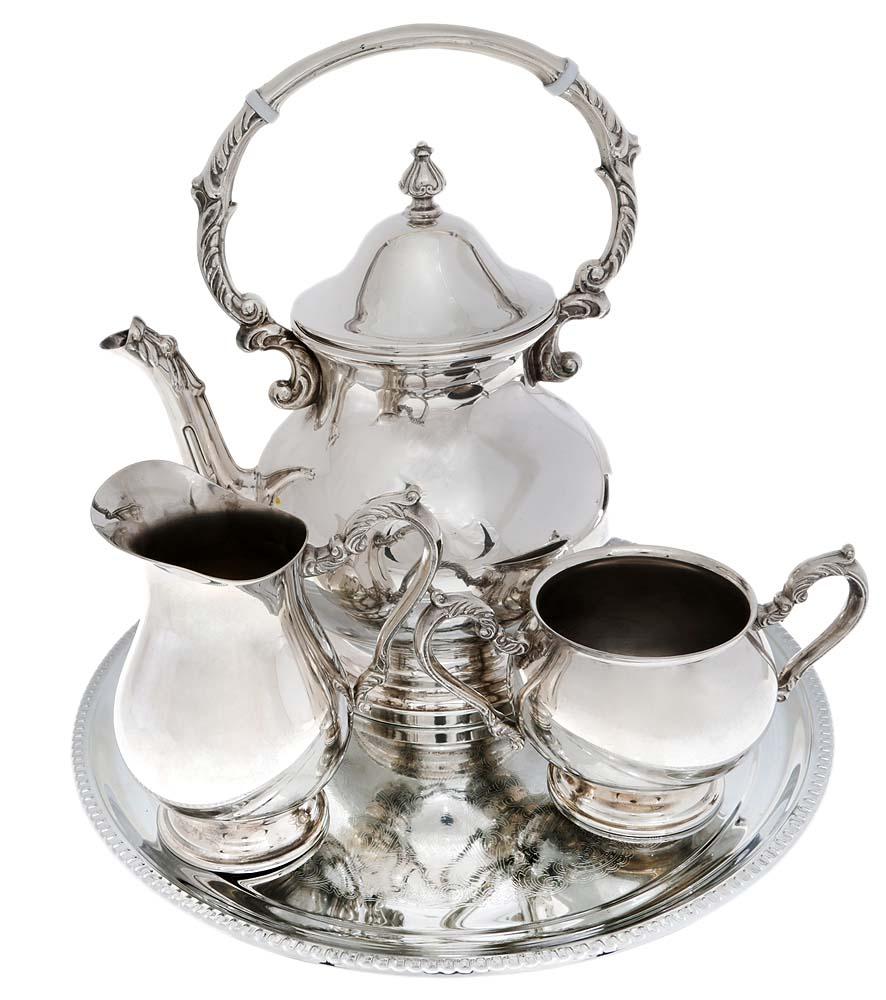 Чайный набор из 4 предметов: сахарница, молочник, чайник, поднос. Металл, серебрение, гравировка. Великобритания, 1930-е гг.ОС27728Превосходный старинный набор для сервировки чая из 4 предметов: сахарница, молочник, чайник, поднос. Металл, серебрение, гравировка. Маркировка: тисненое клеймо M & R. Silver plated. Датировка: Великобритания,1930-е гг. Размеры: Чайник - высота 26 см, диаметр 14 см. Сахарница: высота 9 см, диаметр 9 см. Молочник: высота 13,5 см, диаметр 9 см. Поднос: диаметр 31 см. Сохранность коллекционная. Без повреждений, без утрат. Прекрасный подарок коллекционеру старинного столового серебра!