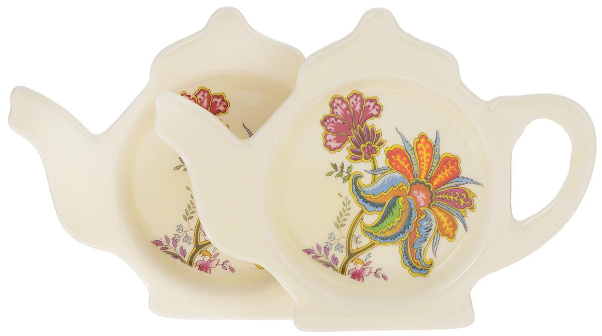 Подставка для чайных пакетиков Loraine, 12,4 х 9 см, 2 шт24831Подставка Loraine, изготовленная из прочной керамики высокого качества, порадует вас оригинальностью и дизайном. Подставка выполнена в форме чайника с изображением цветов. С помощью такой подставки для чайных пакетиков ваша столешница останется чистой. Длина подставки: 12,4 х 9 см. Ширина подставки: 1,5 см.