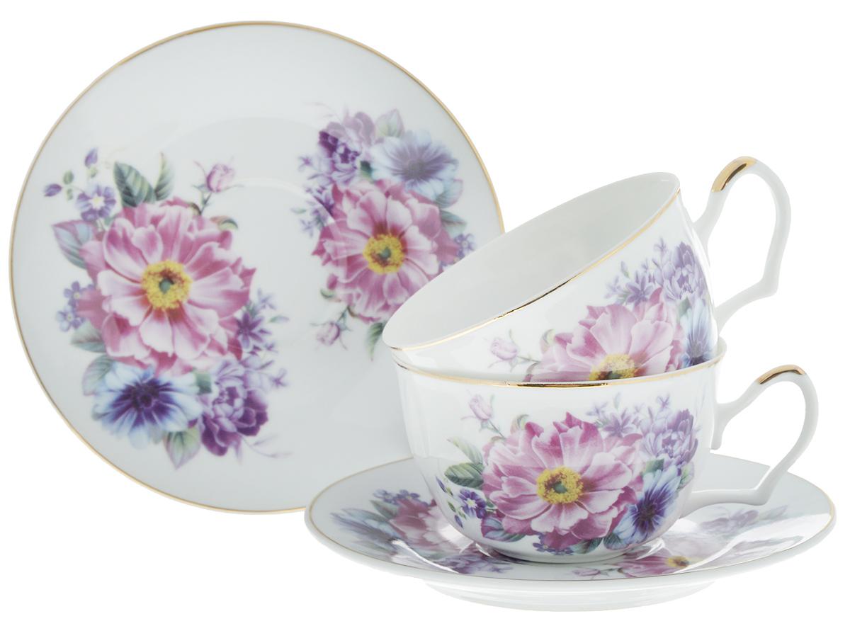 Набор чайный Loraine Фиалки, 4 предмета. 2458624586Чайный набор Loraine Фиалки состоит из 2 чашек и 2 блюдец. Изделия, выполненные из высококачественной керамики, имеют элегантный дизайн и классическую круглую форму. Такой набор прекрасно подойдет как для повседневного использования, так и для праздников. Чайный набор Loraine Фиалки - это великолепное дизайнерское решение для вашей кухни или столовой. Объем чашки: 250 мл. Диаметр чашки (по верхнему краю): 9,7 см. Высота чашки: 6 см. Диаметр блюдца (по верхнему краю): 15,5 см. Высота блюдца: 2 см.