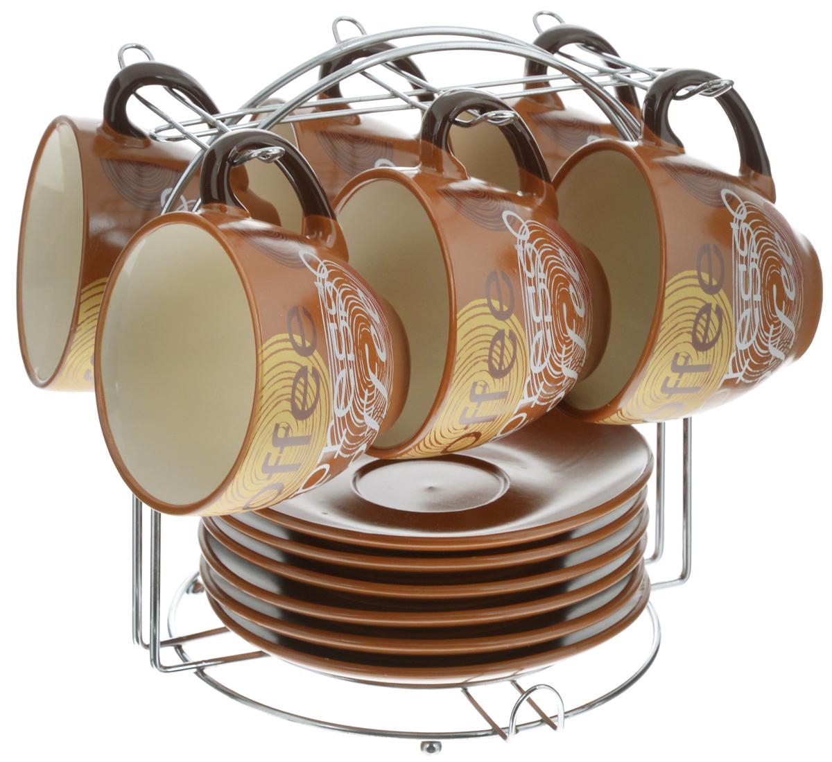 Набор чайный Loraine, на подставке, 13 предметов. 2353723537Набор Loraine состоит из шести чашек и шести блюдец, изготовленных из высококачественной керамики и оформленных стильным рисунком. Изделия расположены на металлической подставке. Такой набор подходит для подачи чая или кофе. Изящный дизайн придется по вкусу и ценителям классики, и тем, кто предпочитает утонченность и изысканность. Он настроит на позитивный лад и подарит хорошее настроение с самого утра. Чайный набор Loraine - идеальный и необходимый подарок для вашего дома и для ваших друзей в праздники. Можно использовать в микроволновой печи, также мыть в посудомоечной машине. Объем чашки: 220 мл. Диаметр чашки по верхнему краю: 9 см. Высота чашки: 7,5 см. Диаметр блюдца: 14,5 см. Высота блюдца: 2,2 см. Размер подставки: 19 х 19,5 х 21 см.