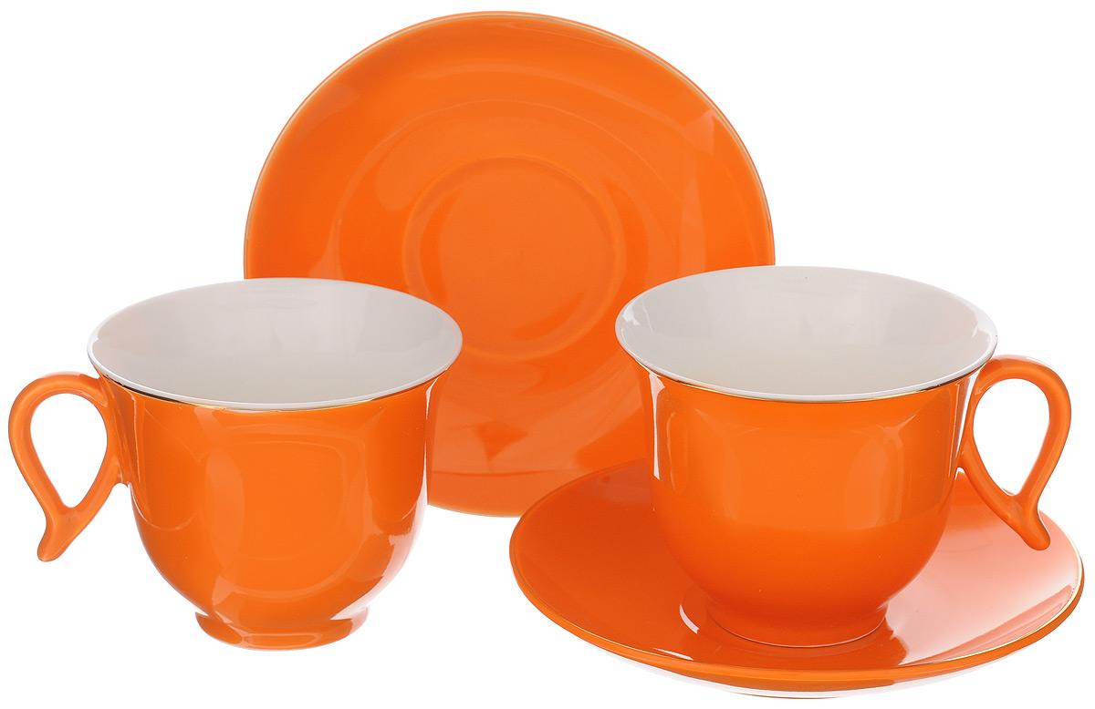 Набор чайный Loraine, цвет: белый, оранжевый, 4 предмета. 2474924749Набор Loraine выполнен из высококачественного фарфора. Изящный дизайн и красочность оформления придутся по вкусу и ценителям классики, и тем, кто предпочитает утонченность и изысканность. Чайный набор - идеальный и необходимый подарок для вашего дома и для ваших друзей в праздники, юбилеи и торжества! Он также станет отличным корпоративным подарком и украшением любой кухни. Чайный набор упакован в подарочную коробку из плотного цветного картона. Внутренняя часть коробки задрапирована белым атласом. Объем чашки: 220 мл. Диаметр чашки (по верхнему краю): 9,5 см. Высота чашки: 7,5 см. Диаметр блюдца: 14 см. Высота блюдца: 2,5 см.