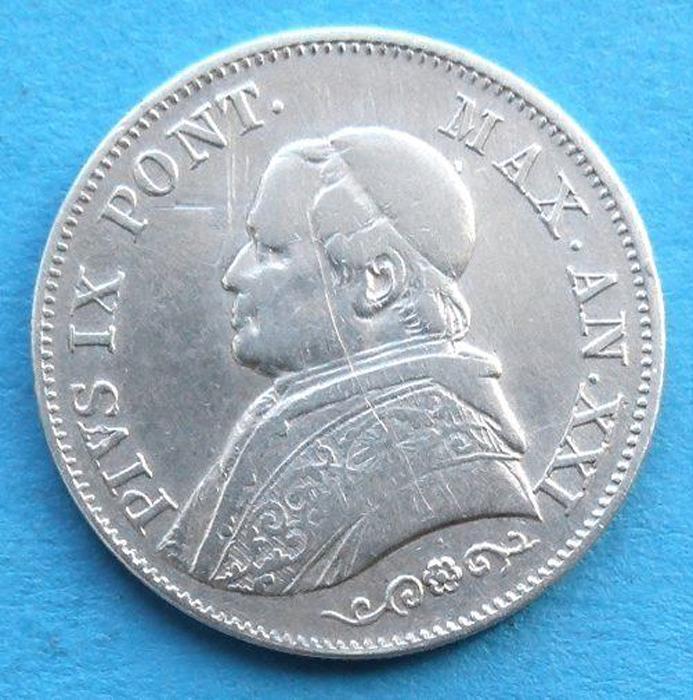 Монета 1 лира. Папское государство (Ватикан, Италия). Пий IX 21 год правления, 1866 год791504Монета 1 лира. Папское государство (Ватикан, Италия). Пий IX 21 год правления, 1866 год. Номинал: 1 лира 1866 год. Сохранность - Extremely Fine (XF) / Отличная. Белый металл. Диаметр: 2,4 см. Вес: 5 г. Аверс: Бюст папы влево. Реверс: Номинал монеты и дата внутри венка. Гурт: Рубчатый. Легенда монеты: На аверсе: PIVS IX. PONТ. MAX. AN. XXI (Пий IX, Папа Римский. 21 год правления). На реверсе: STATO PONTIFICIO. 1 LIRA 1866 (Папское государство. 1 лира 1866 год). Монетный двор: Римский (R).