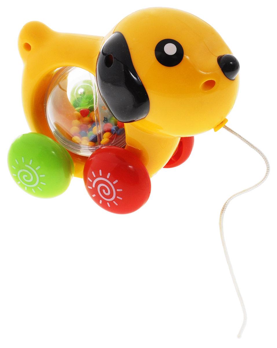 S+S Toys Музыкальная игрушка-каталка СобачкаED80011RМузыкальная игрушка-каталка S+S Toys Собачка станет прекрасным развлечением для вашего малыша. Собачка снабжена веревочкой, а также оснащена звуковыми эффектами. Игрушку можно катать за собой, как машинку, благодаря чему она будет вдохновлять малыша на долгие прогулки и способствовать укреплению его ножек. Малыш узнает, какие звуки издает собачка, послушает красивую мелодию. Игрушка будет способствовать развитию у малыша зрительного и слухового восприятия, моторики. Игрушка подходит для детей от 6 месяцев. Для работы игрушки необходимы 3 батарейки типа AG13 (LR44) (входят в комплект).