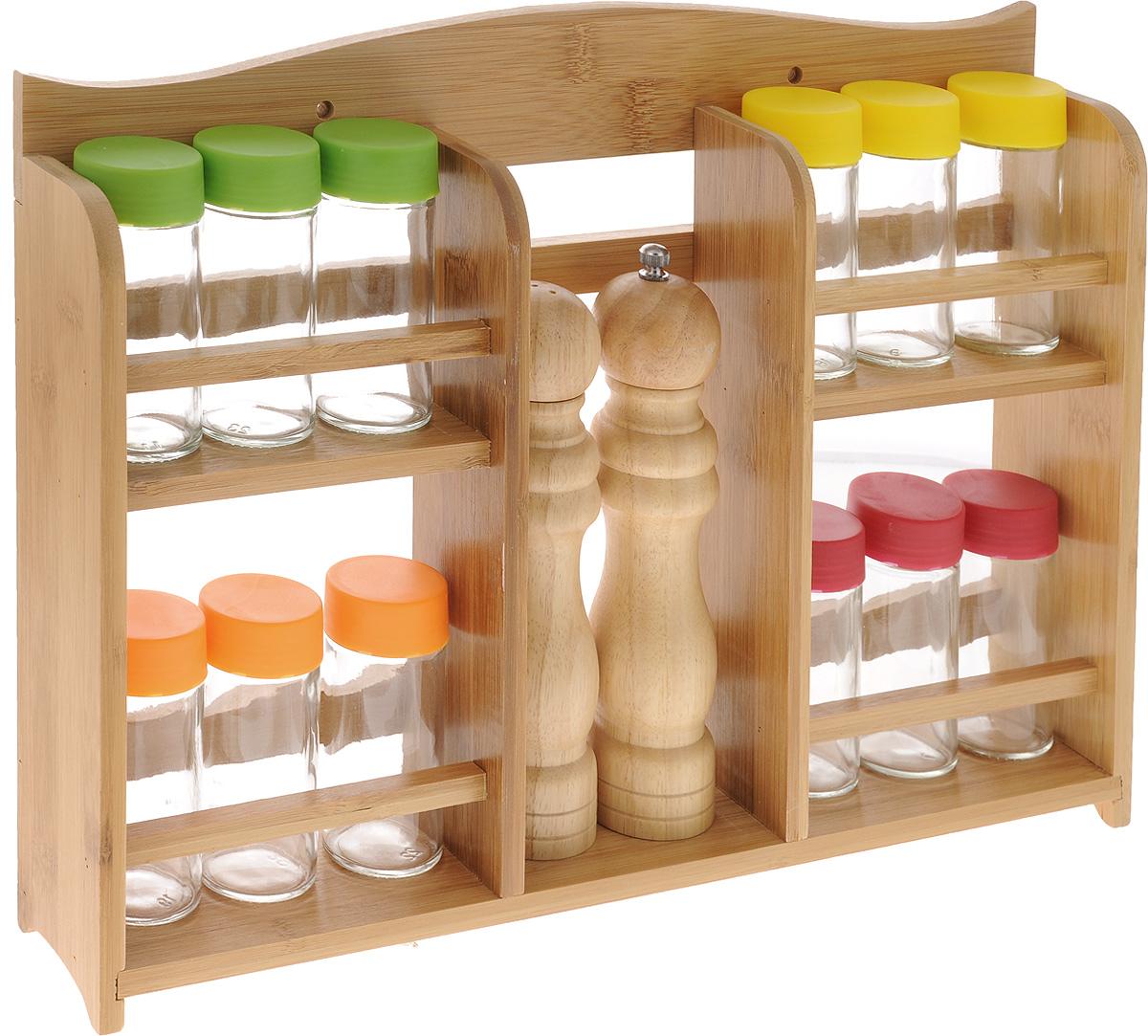 Набор для специй Mayer & Boch, 15 предметов. 2325923259Набор Mayer & Boch состоит из 12 баночек для специй, мельницы для перца, солонки и подставки. Баночки для специй, выполненные из прозрачного стекла, имеют завинчивающиеся цветные пластиковые крышки и перфорированные пластиковые насадки, позволяющие удобно приправлять блюда специями, не опасаясь рассыпать их. Мельница для перца и солонка изготовлены из каучукового дерева. Предметы набора компактно размещаются на бамбуковой двухъярусной подставке. Ее можно закрепить на стене с помощью саморезов (входят в комплект). Очень удобно, когда во время приготовления пищи все приправы под рукой! Набор для специй Mayer & Boch впишется в любой интерьер кухни, а также станет отличным подарком каждой хозяйке. Диаметр баночки (по верхнему краю): 4 см. Высота баночки (с учетом крышки): 10 см. Объем баночки: 100 мл. Диаметр солонки: 5 см. Высота солонки: 20 см. Диаметр мельницы: 5 см. Высота мельницы: 21,5 см. ...