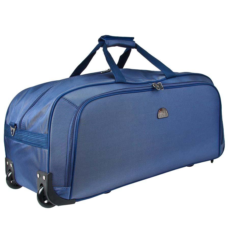Сумка дорожная Polar, 72 л, цвет: синий. 7022.57022.5Дорожная сумка фирмы Polar. Материал - кордура. Большое отделение и карман для мелких вещей. В комплект входит съемный плечевой ремень. Очень удобный и практичный вариант для всего самого необходимого. Пластиковые колеса (2 шт.), выдвижная ручка. Внутренняя тележка.