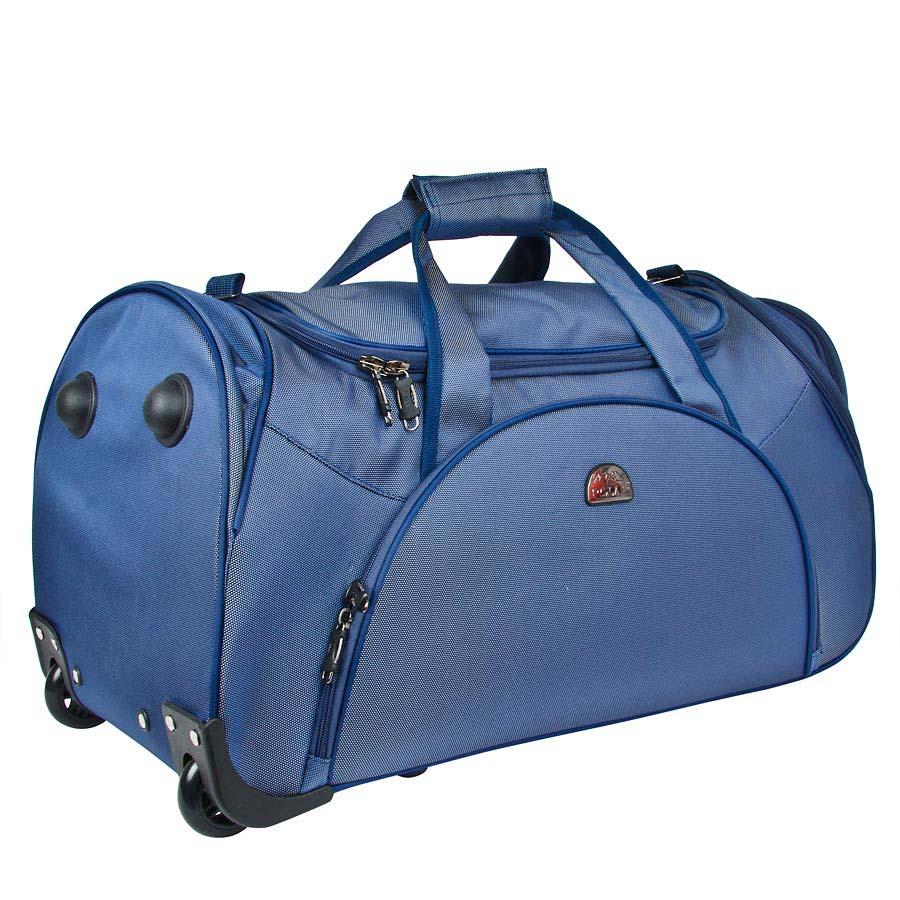 Сумка дорожная на колесах Polar, 75 л, цвет: синий. 7037.57037.5Вместительная дорожная сумка среднего размера фирмы Polar. Материал – кордура. Пластиковые колеса (2 шт.), выдвижная ручка (при горизонтальной транспортировке, ручка прячется под специальный клапан на молнии), внутренняя тележка. Большое отделение с дополнительным карманом на молнии из сетка внутри. На передней части сумки вместительный карман с дополнительным карманом на молнии внутри и два боковых кармана для мелких вещей. В комплект входит съемный плечевой ремень.