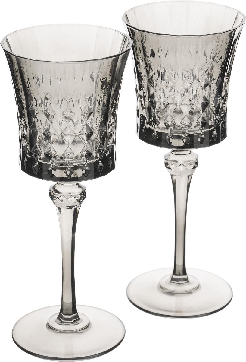 Набор бокалов Cristal dArques Lady Diamond, цвет: серый, 190 мл, 2 штJ1633Набор Cristal dArques Lady Diamond состоит из двух бокалов, выполненных из прочного стекла. Изделия оснащены высокими ножками и предназначены для подачи различных напитков. Они сочетают в себе элегантный дизайн и функциональность. Набор бокалов Cristal dArques Lady Diamond прекрасно оформит праздничный стол и создаст приятную атмосферу за романтическим ужином. Такой набор также станет хорошим подарком к любому случаю. Можно мыть в посудомоечной машине. Диаметр бокала (по верхнему краю): 8 см. Высота бокала: 20,5 см. Диаметр основания: 7,5 см.