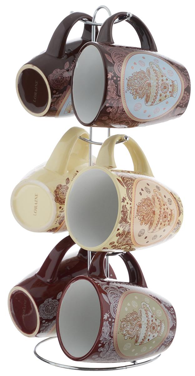 Набор кружек Loraine, на подставке, 7 предметов. 2466324663Набор Loraine состоит из 6 кружек и подставки. Кружки, выполненные из высококачественной керамики с глазурованным покрытием, очень удобны в использовании. Теплостойкие ручки не позволяют обжечь руки во время чаепития. Для компактного хранения кружек предусмотрена металлическая подставка с шестью крючками для подвешивания изделий. Яркий дизайн и качество исполнения сделают такой набор замечательным приобретением для вашей кухни. Можно использовать в микроволновой печи и мыть в посудомоечной машине. Изделия подходят для хранения в холодильнике. Объем кружки: 380 мл. Диаметр кружки (по верхнему краю): 8,5 см. Высота кружки: 10,5 см. Диаметр основания подставки: 14 см. Высота подставки: 37 см.