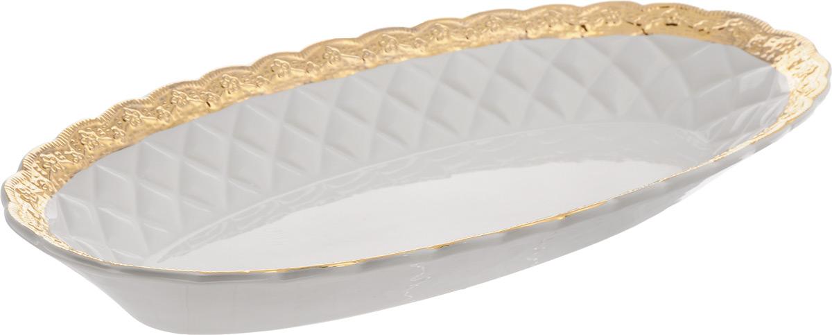 Блюдо Patricia Вивиана, 45,5 х 22,5 х 5,5 смIM18-0204Оригинальное блюдо Patricia Вивиана - прекрасное дополнение праздничного стола. Изделие, выполненное из высококачественного фаянса, оформлено рельефной поверхностью. Блюдо сочетает в себе изысканный дизайн с максимальной функциональностью. Оно идеально подойдет для сервировки стола и станет отличным подарком к любому празднику. Не рекомендуется использовать в микроволновой печи и мыть в посудомоечной машине. Размер блюда (по верхнему краю): 45,5 х 22,5 см. Высота блюда: 5,5 см.
