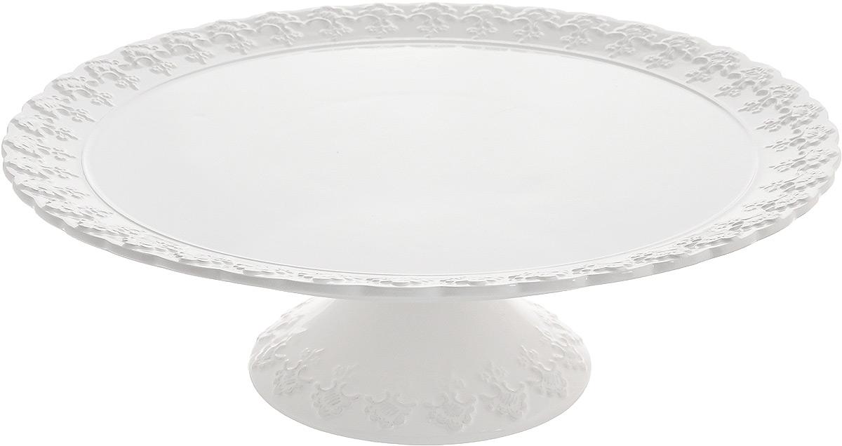 Блюдо для торта Patricia Версаль, диаметр 33 смIM18-0004Блюдо для торта Patricia Версаль выполнено из фаянса с рельефной поверхностью. Посуда обладает гладкой непористой поверхностью и не впитывает запахи, ее легко и просто мыть. Изящный дизайн и красочность оформления придутся по вкусу и ценителям классики, и тем, кто предпочитает утонченность и изысканность. Не рекомендуется мыть в посудомоечной машине и использовать в микроволновой печи. Диаметр блюда: 33 см.