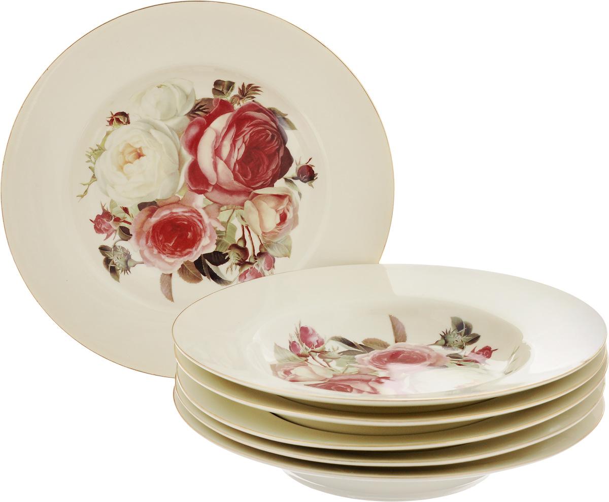 Набор суповых тарелок Patricia Яркая роза, диаметр 22,5 см, 6 штIM4645Набор Patricia Яркая роза, выполненный из высококачественной глазурованной керамики, состоит из 6 суповых тарелок. Изделия украшены цветочным рисунком и предназначены для красивой сервировки и подачи первых блюд. Набор сочетает в себе стильный дизайн с максимальной функциональностью. Оригинальность оформления придется по вкусу и ценителям классики, и тем, кто предпочитает утонченность и изящность. Не рекомендуется использовать в микроволновой печи и мыть в посудомоечной машине. Диаметр (по верхнему краю): 22,5 см.
