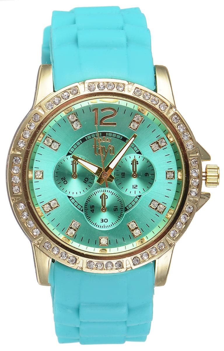 Часы наручные женские Taya, цвет: золотистый, бирюзовый. T-W-0228T-W-0228-WATCH-GL.GREENСтильные женские часы Taya выполнены из минерального стекла, силикона и нержавеющей стали. Циферблат и корпус часов инкрустированы стразами и оформлены символикой бренда. Корпус часов оснащен кварцевым механизмом со сменным элементом питания, а также силиконовым ремешком с практичной пряжкой. Циферблат дополнен тремя декоративными отметками. На стрелки нанесен светящийся состав. Часы поставляются в фирменной упаковке. Часы Taya подчеркнут изящность женской руки и отменное чувство стиля у их обладательницы.