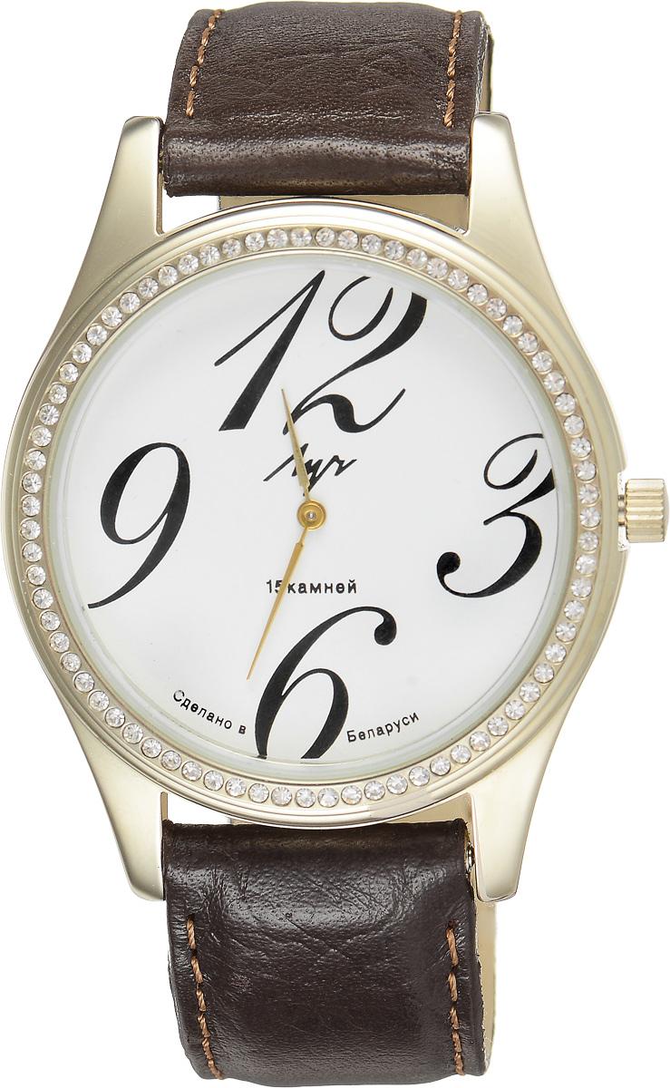 Часы наручные женские Луч, цвет: золотой, коричневый. 378777404378777404Стильные часы Луч выполнены из металлического сплава и силикатного стекла. Корпус часов имеет покрытие из нитрида циркония, которое обладает особой стойкостью к стиранию и не вызывает аллергических реакций кожи. Циферблат оформлен символикой бренда, корпус инкрустирован стразами. Механические часы с 15 камнями дополнены ремешком из натуральной кожи, который застегивается на практичную пряжку. Часы поставляются в фирменной упаковке. Часы Луч подчеркнут изящность женской руки и отменное чувство стиля у их обладательницы.