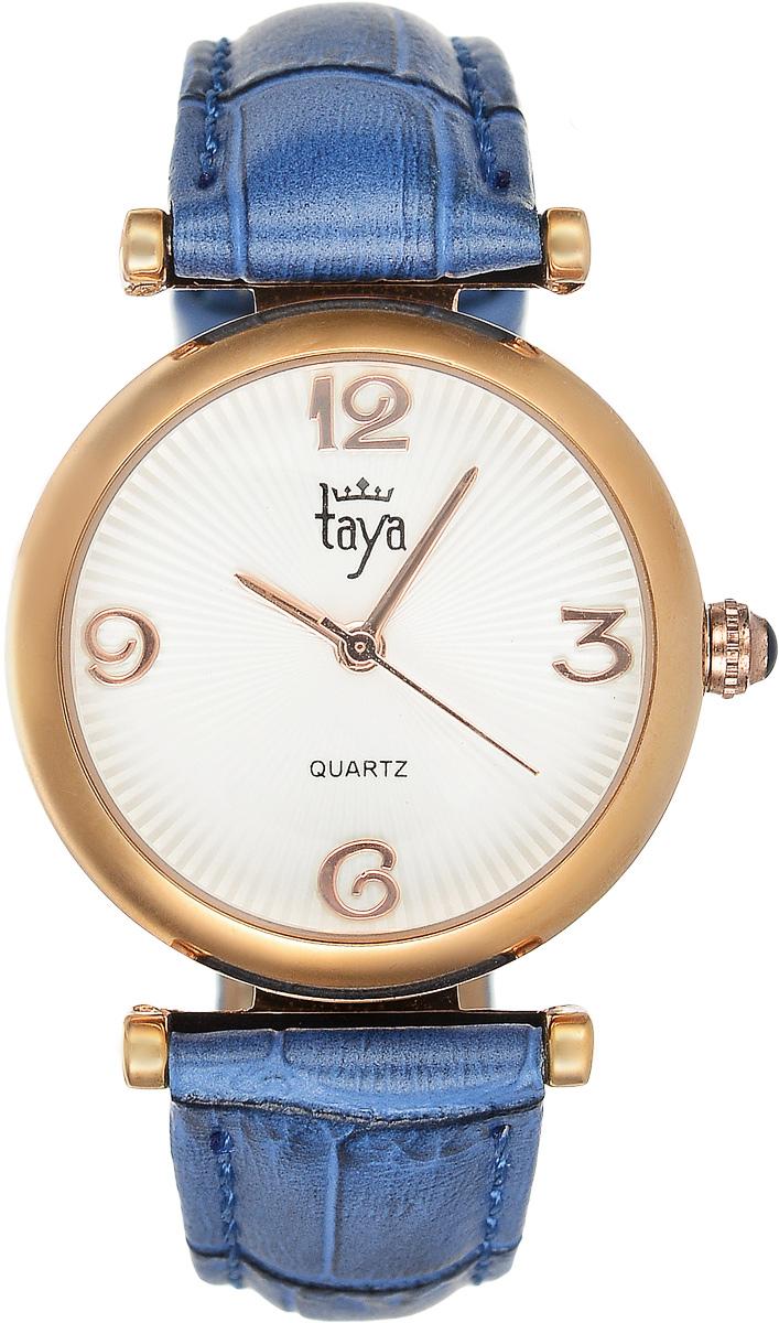 Часы наручные женские Taya, цвет: золотистый, синий. T-W-0017T-W-0017-WATCH-GL.D.BLUEЭлегантные женские часы Taya выполнены из минерального стекла, натуральной кожи и нержавеющей стали. Циферблат часов украшен символикой бренда. Корпус часов оснащен кварцевым механизмом со сменным элементом питания, а также дополнен ремешком из натуральной кожи, который застегивается на пряжку. Ремешок декорирован тиснением под кожу рептилии. Часы поставляются в фирменной упаковке. Часы Taya подчеркнут изящность женской руки и отменное чувство стиля у их обладательницы.