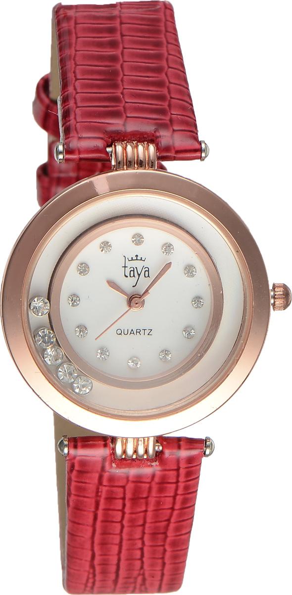 Часы наручные женские Taya, цвет: золотистый, красный. T-W-0026T-W-0026-WATCH-GL.REDЭлегантные женские часы Taya выполнены из минерального стекла, искусственной кожи и нержавеющей стали. Циферблат инкрустирован стразами и дополнен символикой бренда. Корпус часов оформлен пятью стразами, перемещающимися по окружности. Корпус часов оснащен кварцевым механизмом со сменным элементом питания, а также дополнен ремешком из искусственной кожи, который застегивается на пряжку. Ремешок декорирован тиснением под кожу рептилии. Часы поставляются в фирменной упаковке. Часы Taya подчеркнут изящность женской руки и отменное чувство стиля у их обладательницы.