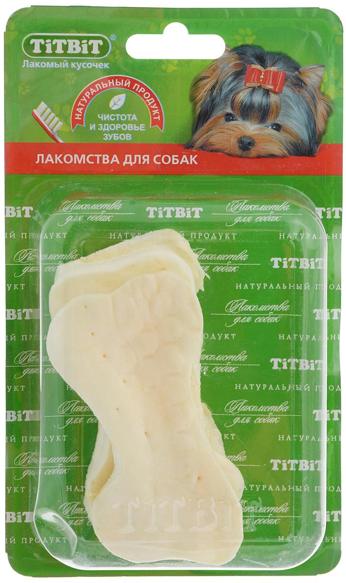 Лакомство для собак Titbit, мясная слоеная косточка, 2 шт5455Лакомство для собак Titbit выполнено из высушенной говяжьей кожи, свернутой в форме косточек. Благодаря большому содержанию аминокислот и коллагена, положительно воздействует на состояние кожи и шерсти собаки, а также обеспечивает поступление в организм незаменимых компонентов для роста и поддержания качества хрящевой ткани суставов собак. Способствует укреплению десен, удалению зубного налета и профилактике образования зубного камня. Прекрасное лакомство для всех собак с 1,5-2 месячного возраста. Состав: высушенная говяжья кожа. Товра сертифицирован.