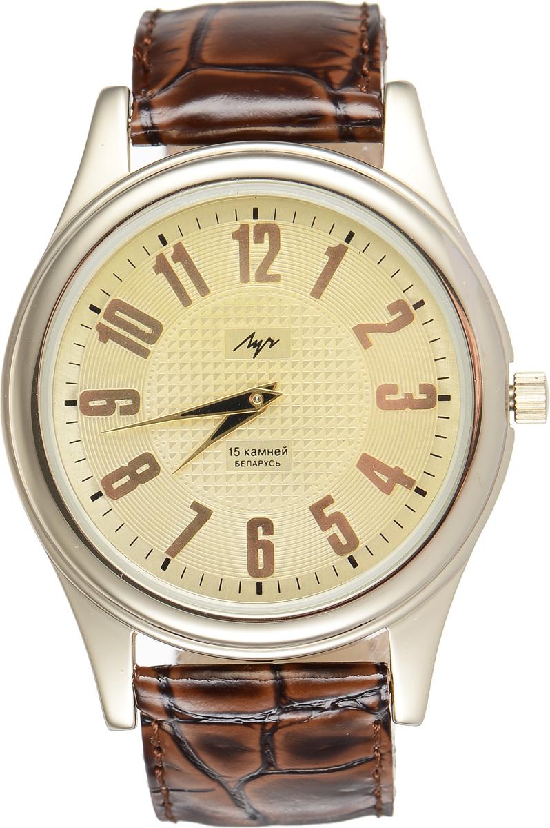 Часы наручные мужские Луч, цвет: золотой, коричневый. 378777400378777400Стильные часы Луч выполнены из металлического сплава и силикатного стекла. Корпус имеет покрытие из нитрида циркония, которое обладает особой стойкостью к стиранию. Циферблат оформлен символикой бренда. Механические часы с 15 рубиновыми камнями и противоударным устройством оси баланса дополнены ремешком из натуральной кожи с лаковым покрытием и декоративным тиснением, который застегивается на практичную пряжку. Часы поставляются в фирменной упаковке. Часы Луч подчеркнут отменное чувство стиля их обладателя.