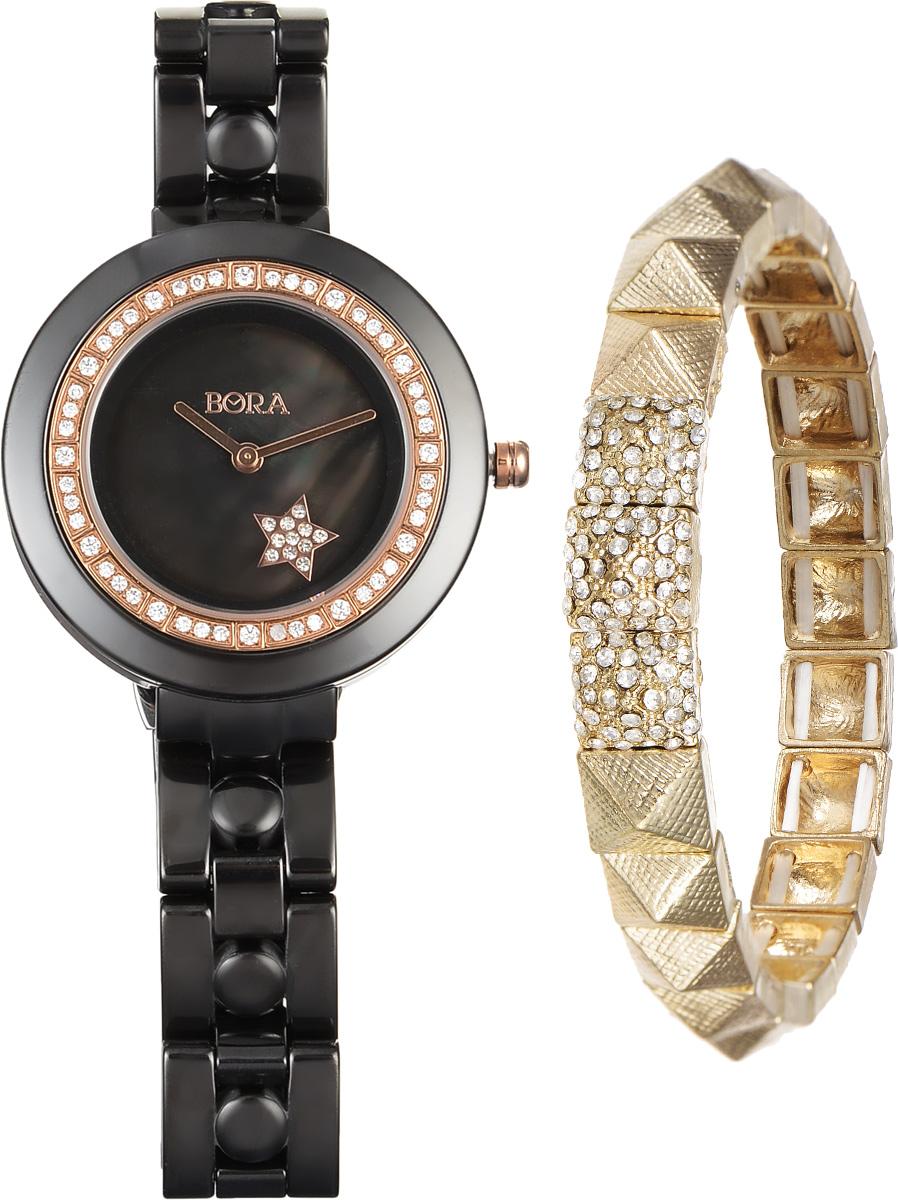 Часы наручные женские Bora, с браслетом, цвет: черный, золотой. T-B-6715T-B-6715-WATCH-BLACKЭлегантные женские часы Bora выполнены из керамики и минерального стекла. Корпус часов украшен стразами. Перламутровый циферблат дополнен символикой бренда и оформлен декоративным элементом в виде звезды, которая инкрустирована стразами. Корпус часов оснащен кварцевым механизмом со сменным элементом питания, а также дополнен браслетом, который застегивается на застежку-бабочку. Стильный браслет выполнен из бижутерийного сплава и декорирован тремя элементами, инкрустированными стразами и эффектно дополняющими украшение. Благодаря эластичной основе браслет идеально разместится на запястье. Часы и браслет поставляются в фирменной упаковке. Часы Bora с браслетом подчеркнут изящность женской руки и отменное чувство стиля у их обладательницы.