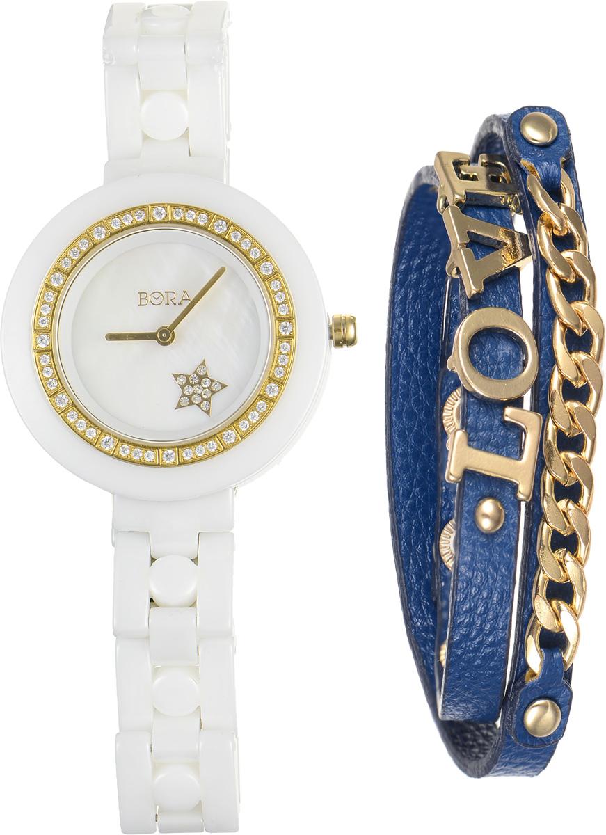 Часы наручные женские Bora, с браслетом, цвет: белый, золотой, синий. T-B-6712T-B-6712-WATCH-WHITEЭлегантные женские часы Bora выполнены из керамики и минерального стекла. Корпус часов также украшен стразами. Перламутровый циферблат дополнен символикой бренда и оформлен декоративным элементом в виде звезды, которая инкрустирована стразами. Корпус часов оснащен кварцевым механизмом со сменным элементом питания, а также дополнен браслетом, который застегивается на металлическую застежку-бабочку. Стильный браслет выполнен из искусственной кожи с декоративными элементами из бижутерийного сплава. Эффектно дополняет украшение надпись Love, выполненная из подвижных элементов. Украшение застегивается на кнопку. Часы и браслет поставляются в фирменной упаковке. Часы Bora с браслетом подчеркнут изящность женской руки и отменное чувство стиля у их обладательницы.