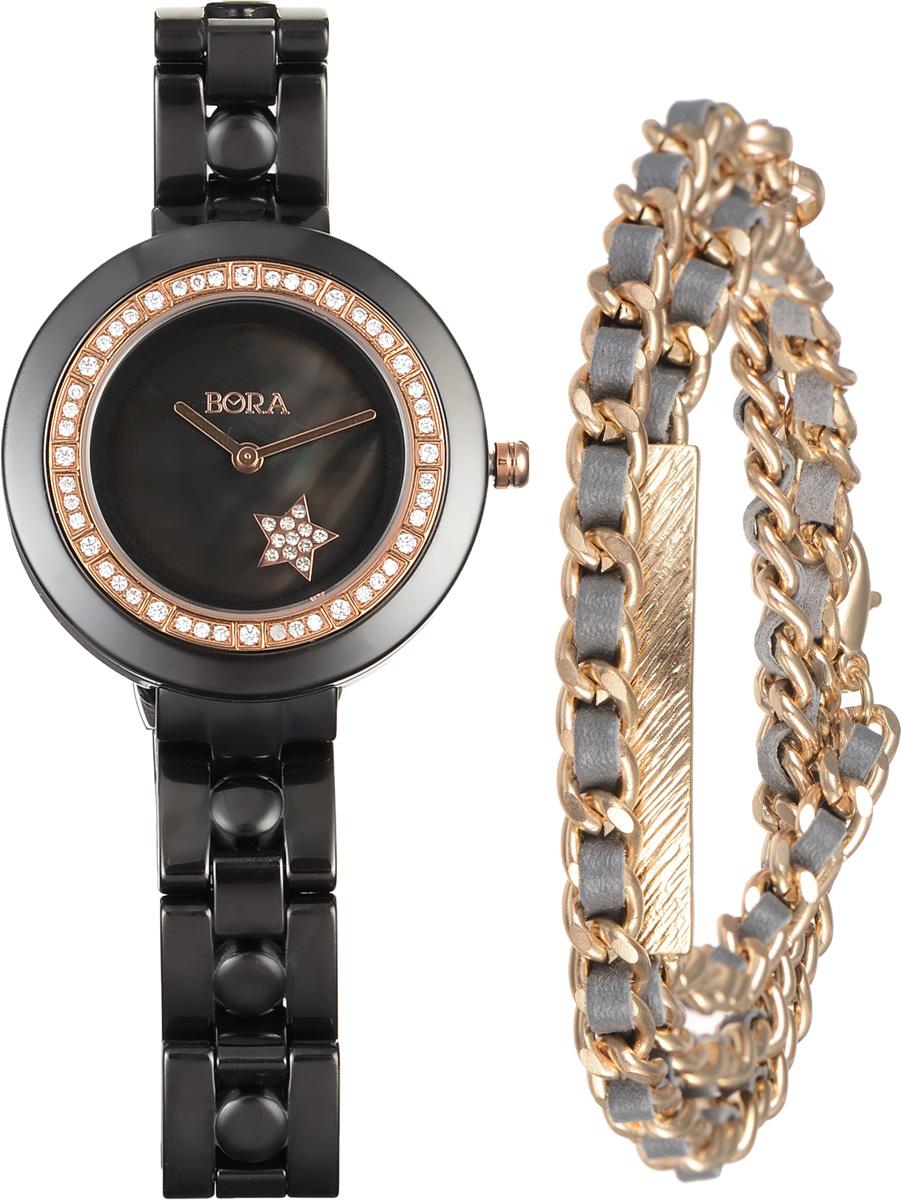 Часы наручные женские Bora с браслетом, цвет: черный, золотой. T-B-6714T-B-6714-WATCH-BLACKЭлегантные женские часы Bora выполнены из керамики и минерального стекла. Корпус часов украшен стразами. Перламутровый циферблат дополнен символикой бренда и оформлен декоративным элементом в виде звезды, которая инкрустирована стразами. Корпус часов оснащен кварцевым механизмом со сменным элементом питания, а также дополнен браслетом, который застегивается на застежку-бабочку. Стильный браслет выполнен из бижутерийного сплава и искусственной кожи, оформлен прямоугольной пластиной с рельефной гравировкой. Украшение застегивается на практичный замок-карабин. Часы и браслет поставляются в фирменной упаковке. Часы Bora с браслетом подчеркнут изящность женской руки и отменное чувство стиля у их обладательницы.