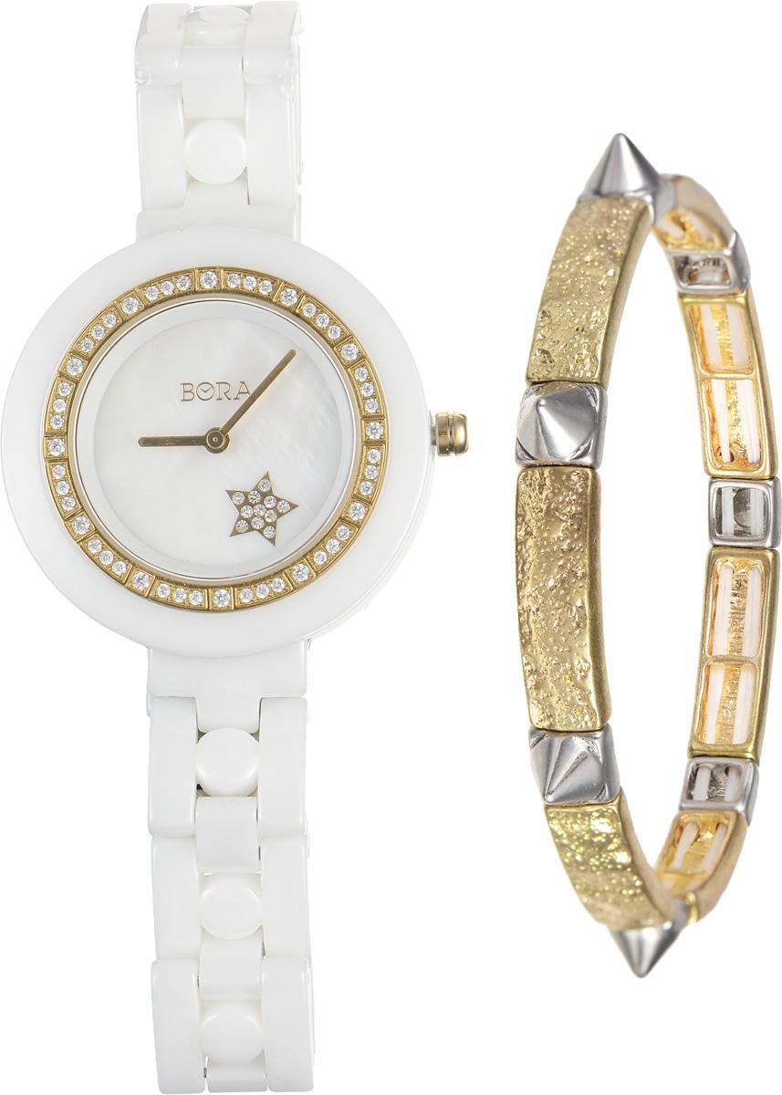Часы наручные женские Bora, с браслетом, цвет: белый, золотой. T-B-6711T-B-6711-WATCH-WHITEЭлегантные женские часы Bora выполнены из керамики и минерального стекла. Корпус часов украшен стразами. Перламутровый циферблат дополнен символикой бренда и оформлен декоративным элементом в виде звезды, которая инкрустирована стразами. Корпус часов оснащен кварцевым механизмом со сменным элементом питания, а также дополнен браслетом, который застегивается на застежку-бабочку. Стильный браслет выполнен из бижутерийного сплава. Декоративные элементы в форме шипов эффектно дополняют украшение. Благодаря эластичной основе браслет идеально разместится на запястье. Часы и браслет поставляются в фирменной упаковке. Часы Bora с браслетом подчеркнут изящность женской руки и отменное чувство стиля у их обладательницы.