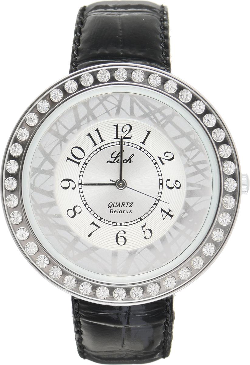 Часы наручные женские Луч, цвет: серебряный, черный. 3540134235401342Элегантные женские часы Луч выполнены из металлического сплава и силикатного стекла. Корпус с покрытием из хрома обладает высокой стойкостью к стиранию. Корпус часов инкрустирован стразами. Циферблат оформлен символикой бренда. Часы оснащены кварцевым механизмом со сменным элементом питания, а также дополнены ремешком из натуральной кожи с лаковым покрытием и декоративным тиснением, который застегивается на практичную пряжку. Часы Луч подчеркнут изящность женской руки и отменное чувство стиля у их обладательницы.