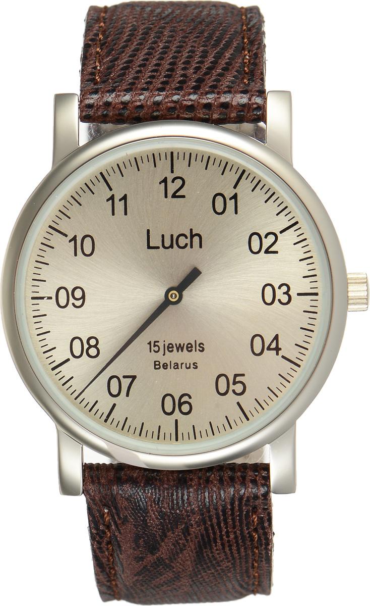 Часы наручные мужские Луч, цвет: золотистый, коричневый. 337477761337477761Стильные часы Луч выполнены из металлического сплава и силикатного стекла. Круглый корпус часов имеет покрытие из нитрида циркония, обладающее особой стойкостью к стиранию, циферблат оформлен символикой бренда. Механические часы с 15 рубиновыми камнями и противоударным устройством оси баланса дополнены ремешком из натуральной кожи с декоративным тиснением, который застегивается на практичную пряжку. Часы Луч подчеркнут мужской характер и отменное чувство стиля их обладателя.