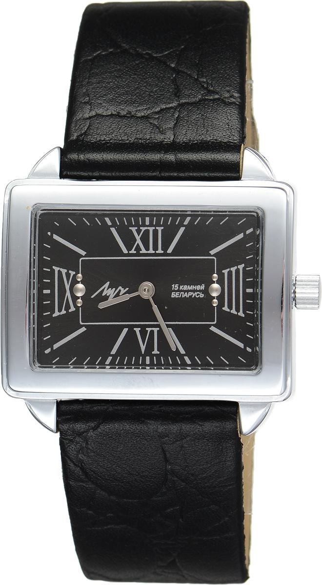 Часы наручные женские Луч, цвет: черный, серебряный. 7077162970771629Стильные часы Луч выполнены из металлического сплава и органического стекла. Прямоугольный корпус часов имеет напыление из хрома, циферблат оформлен символикой бренда. Механические часы с 15 рубиновыми камнями и противоударным устройством оси баланса дополнены ремешком из натуральной кожи с декоративным тиснением, который застегивается на практичную пряжку. Часы Луч подчеркнут изящность женской руки и отменное чувство стиля их обладательницы.