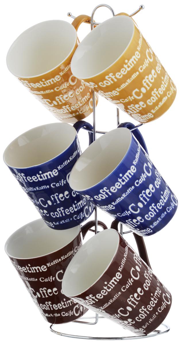 Набор кружек Loraine, цвет: синий, желтый, коричневый, 7 предметов. 2466224662_синий, желтый, коричневыйНабор Loraine состоит из 6 кружек и подставки. Кружки выполнены из высококачественной керамики с глазурованным покрытием. Теплостойкие ручки не позволяют обжечь руки во время чаепития. Для хранения кружек предусмотрена металлическая подставка с удобной ручкой для переноски. Яркий дизайн и качество исполнения сделают такой набор замечательным приобретением для вашей кухни. Можно использовать в микроволновой печи и мыть в посудомоечной машине. Диаметр кружки (по верхнему краю): 9 см. Высота кружки: 10 см. Объем кружки: 340 мл. Высота подставки: 38 см.
