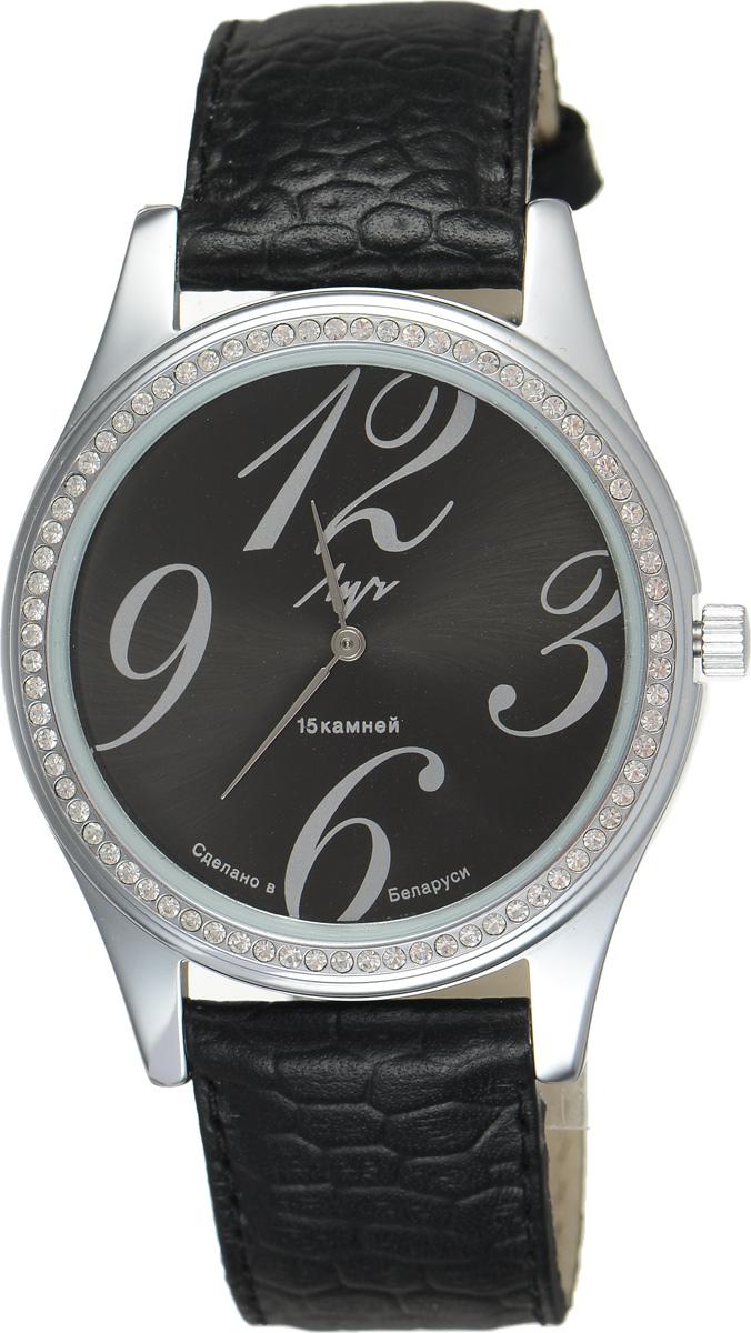 Часы наручные женские Луч, цвет: серебряный, черный. 7877140278771402Стильные часы Луч выполнены из металлического сплава и силикатного стекла. Корпус часов имеет покрытие из хрома, которое обладает особой стойкостью к стиранию и не вызывает аллергических реакций кожи. Циферблат оформлен символикой бренда, корпус инкрустирован стразами. Механические часы с 15 камнями дополнены ремешком из натуральной кожи, который застегивается на практичную пряжку. Кожаный ремешок оформлен тиснением под кожу рептилии. Часы поставляются в фирменной упаковке. Часы Луч подчеркнут изящность женской руки и отменное чувство стиля у их обладательницы.