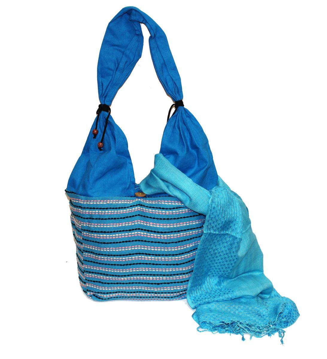 Ethnica Хлопковая сумка-торба, цвет: голубой, в полоску. 122150122150Пляжная женская сумка Ethnica выполнена из хлопковой ткани с декоративной ручной отделкой. Модель с одним отделением, застегивается на пуговицу.