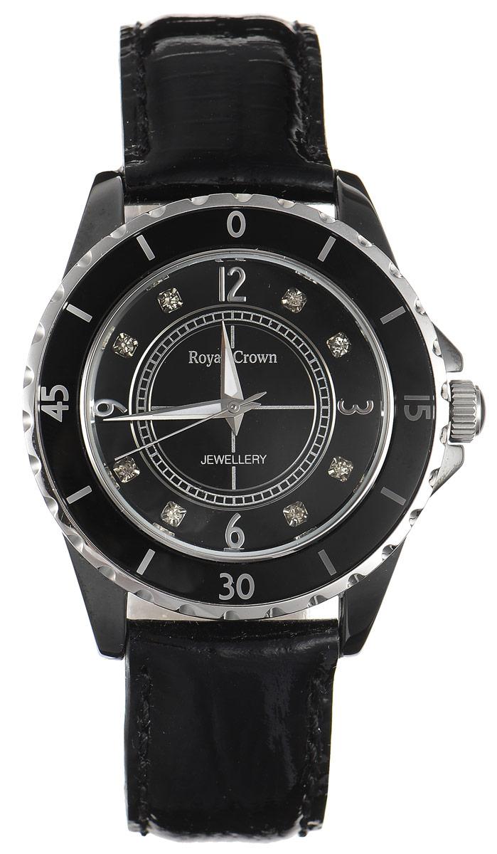 Часы наручные женские Royal Crown, цвет: черный, серебристый. 3821M-6-RDM-13821M-6-RDM-1Стильные женские часы Royal Crown изготовлены из высокотехнологичной гипоаллергенной нержавеющей стали, керамики и латуни. Браслет выполнен из натуральной лаковой кожи и оформлен с внутренней стороны тиснением логотипа бренда. Покрытие корпуса - палладий с добавлением родия, что придает часам благородный блеск драгоценных металлов. Для того чтобы защитить циферблат от повреждений в часах используется высокопрочное минеральное стекло. Кварцевый механизм имеет степень влагозащиты равную 5 Bar и дополнен часовой, минутной и секундной стрелками. Корпус часов обрамлен дополнительным рядом с отметками и цифрами, в переводе в минуты. На циферблате арабские цифры и отметки в виде сверкающих чешских цирконов органично сочетаются со строгими стрелками. Браслет комплектуется надежной и удобной в использовании застежкой-пряжкой, которая позволит с легкостью снимать и надевать часы, а также регулировать длину браслета. Часы упакованы в фирменную коробку с прозрачным окошком и...