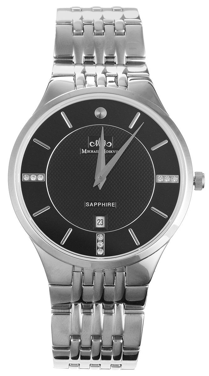 Часы наручные мужские Mikhail Moskvin Elegance, цвет: серебряный, черный. G5001S0B1G5001S0B1Стильные мужские наручные часы Mikhail Moskvin из серии Elegance изготовлены из высокотехнологичной гипоаллергенной нержавеющей стали. Модель органично сочетает в себе технологичность и строгость, оформлена символикой бренда и стразами. Для того чтобы защитить циферблат от повреждений в часах используется высокопрочное сапфировое стекло. Серебристая часовая индикация в виде удлиненных знаков дополнена гранеными стрелками и индикатором даты. Корпус часов оснащен кварцевым механизмом, степенью влагозащиты равной 3 Bar. Браслет комплектуется надежной и удобной в использовании застежкой-клипсой, которая позволит с легкостью снимать и надевать часы. Часы упакованы в фирменную коробку и дополнительно в подарочную сумку с названием бренда. Часы Mikhail Moskvin подчеркнут мужской характер и отменное чувство стиля их обладателя.