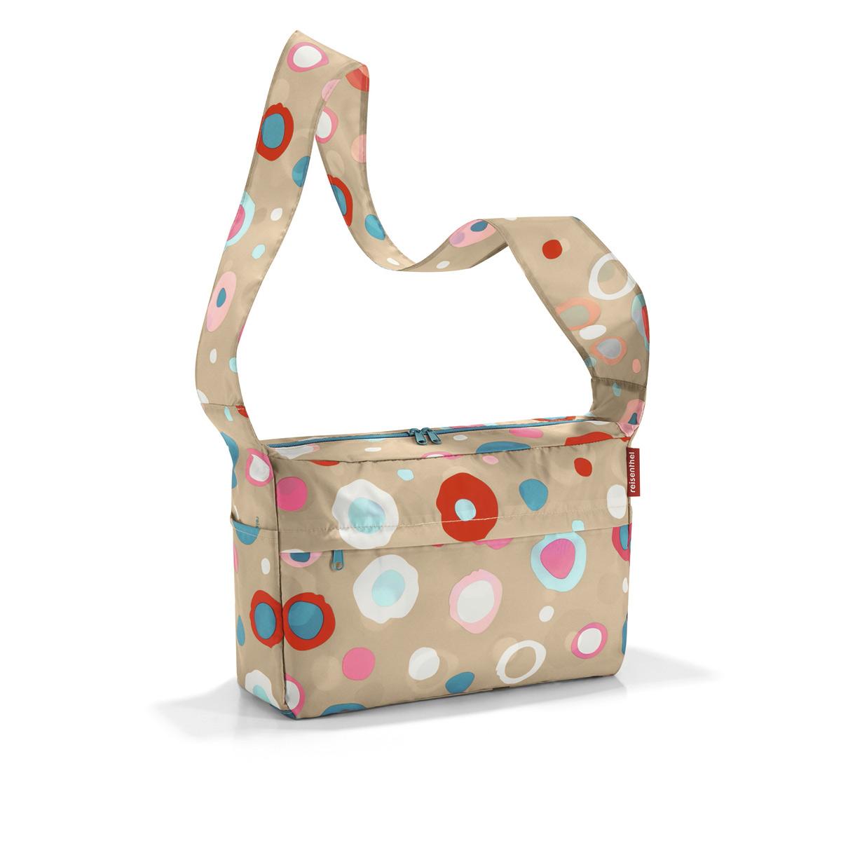 Сумка женская Reisenthel, складная, цвет: бежевый, синий, розовый. AL6034AL6034Стильная женская сумка Reisenthel изготовлена из текстиля с оригинальным принтом. Сумка имеет одно отделение, которое закрывается на застежку-молнию с двумя бегунками. Внутри имеется нашивной карман на застежке-молнии, в который сумка складывается и приобретает компактный вид. Снаружи, на передней стенке расположен накладной карман на застежке-молнии, по бокам - открытые накладные карманы. Изделие оснащено удобным плечевым ремнем.