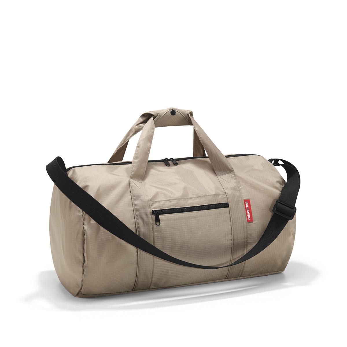 Сумка складная Reisenthel, цвет: бежевый. AM7031AM7031Универсальная сумка-трансформер серии Mini Maxi, предназначенная для путешествий и спорта. - для хранения компактно складывается в собственный внутренний карман; - вместительное основное отделение на молнии; - экономит место при хранении и перевозке в сложенном состоянии; - регулируемый наплечный ремень; - ручки для переноски, регулируемые при помощи специальных застежек; - два внешних кармана на молнии; - материал: высококачественный водостойкий полиэстер; - объем – 20 литров.